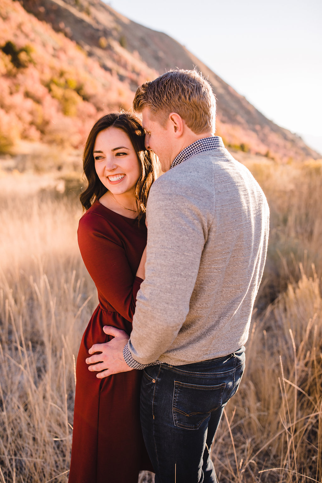 adventurous mountain engagement session frolicking through the fields logan utah green canyon engagement pictures calli richards