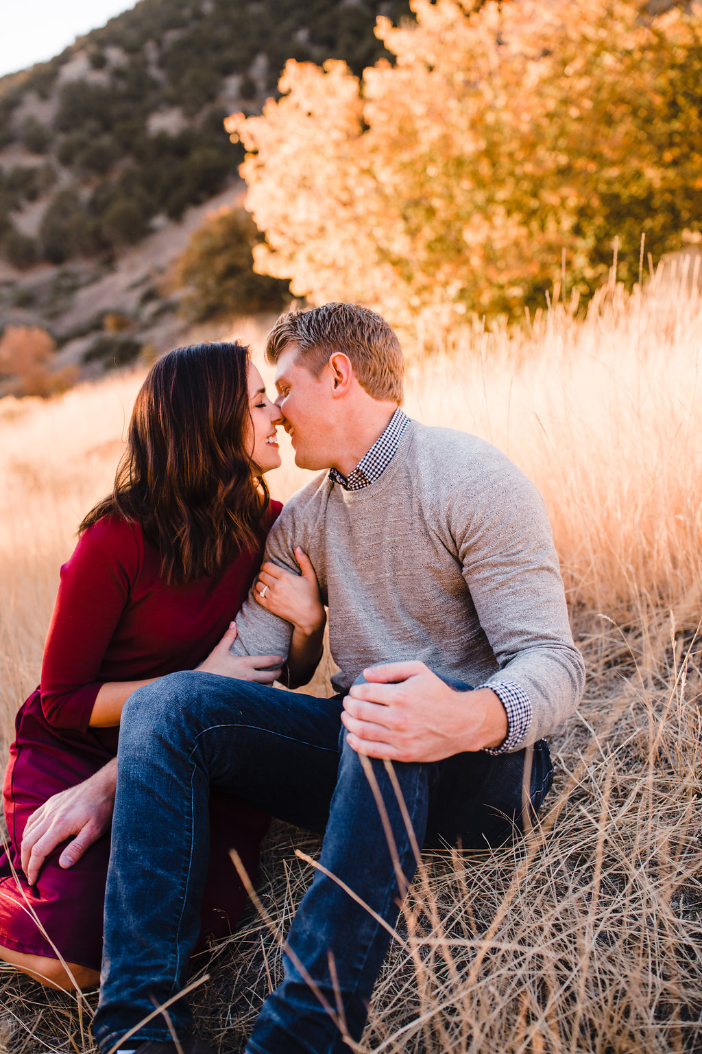 noses touching cute engagement pictures fall red and yellow leaves green canyon mountain engagement photos calli richards logan utah adventurous couples photographer