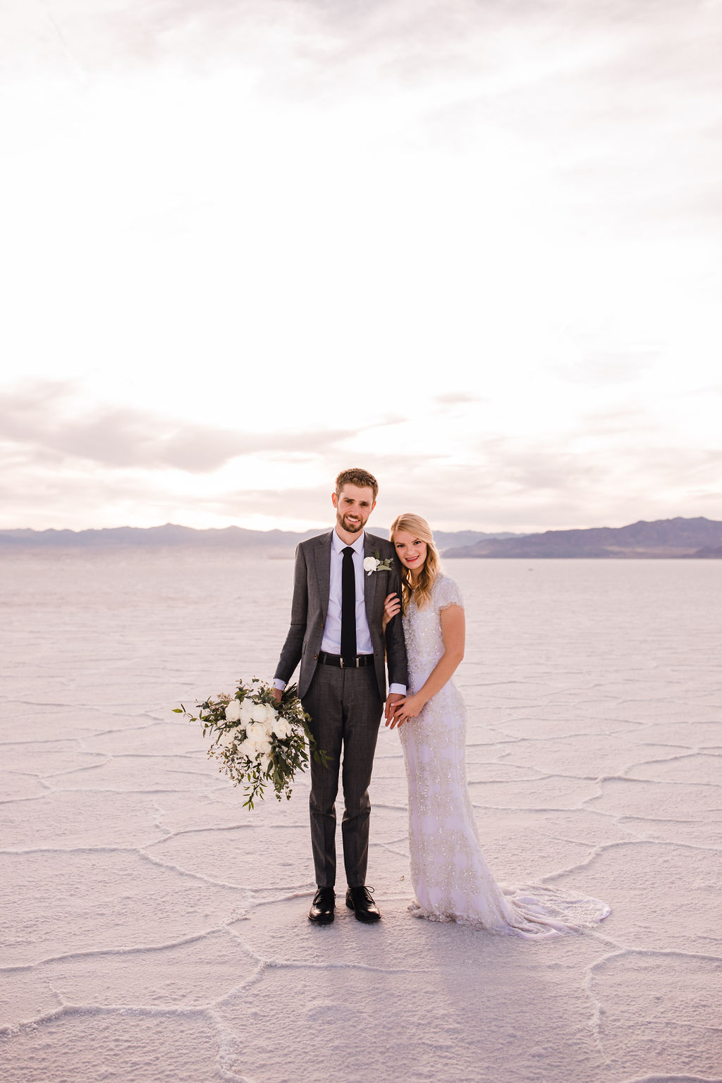 professional salt lake city utah formal photographer salt flats sunset pink sky white bouquet