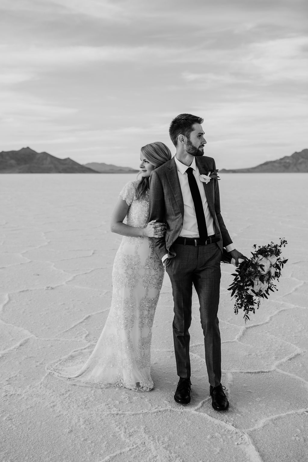 salt lake city utah professional formal photographer salt flats hugging romantic beaded wedding gown