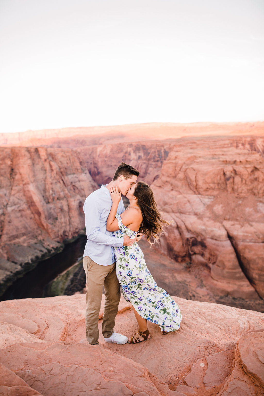 best couples photographer grand canyon page arizona horseshoe bend red rocks cliffs flowing floral dress kissing romantic