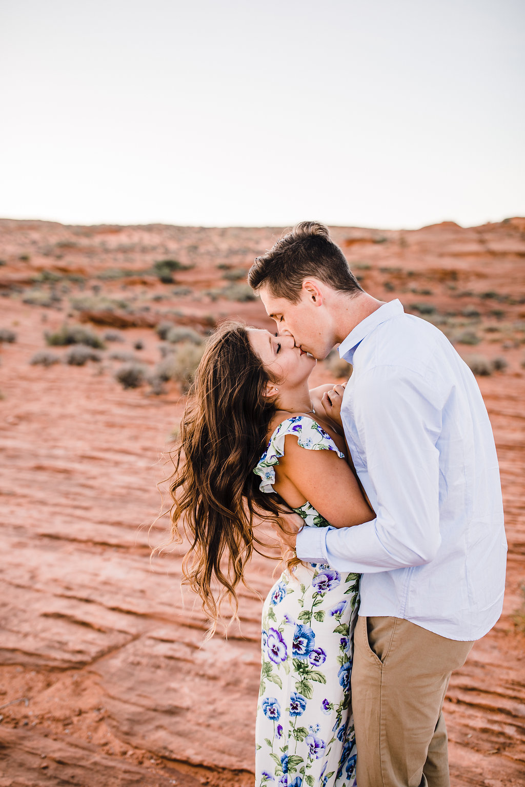 page arizona professional wedding photographer kissing romantic desert floral dress windy hair