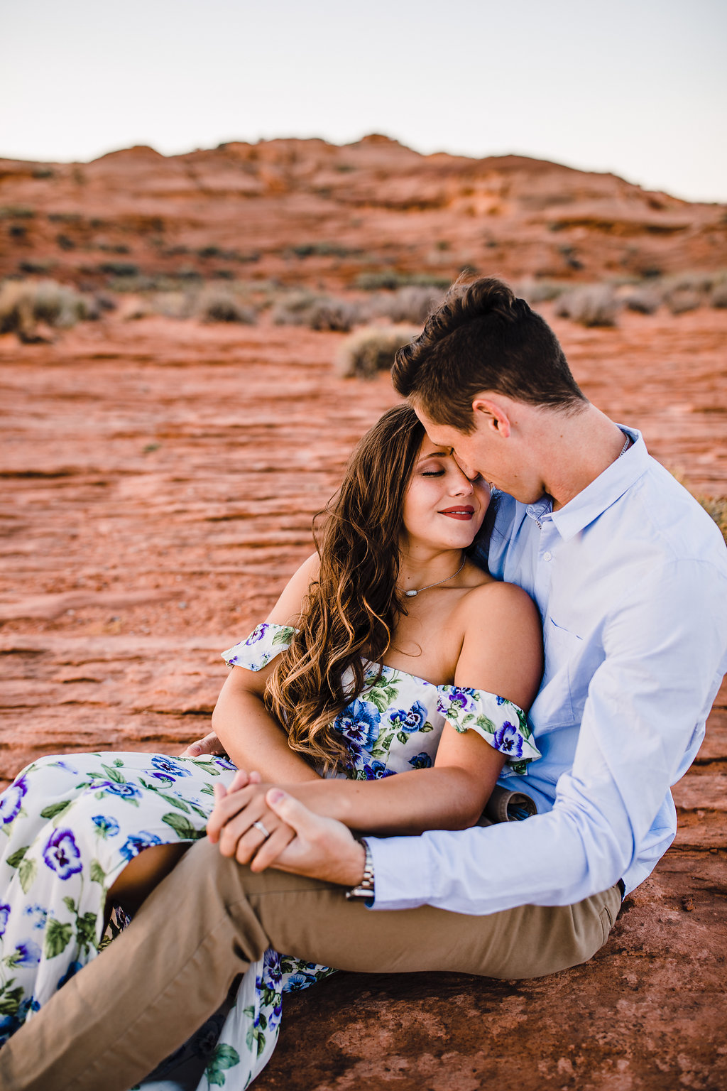 page arizona couples photographer cuddling sitting floral sleeveless dress curly hair red rocks grand canyon
