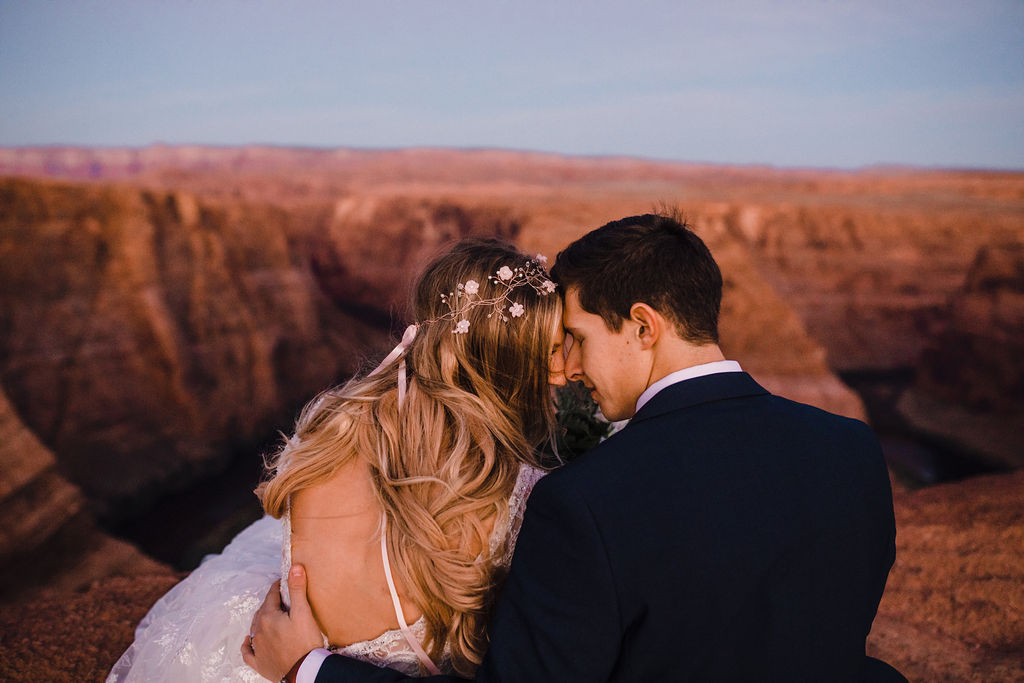 best grand canyon photographer formals hugging romantic sunset red rocks grand canyon backless dress white flower crown