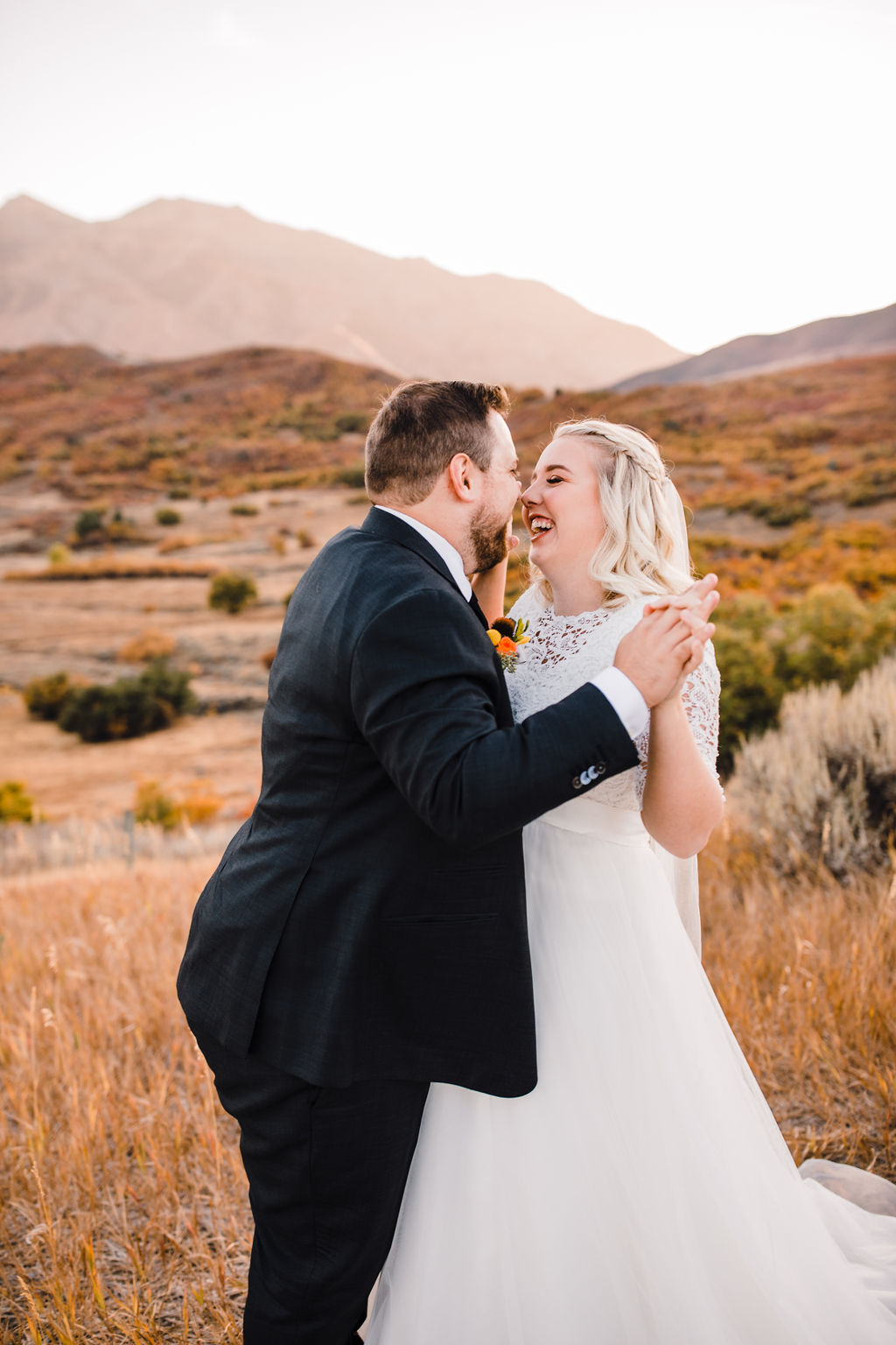 best professional formal photographer ogden utah hugging holding hands laughing smiling playful fall colors mountains
