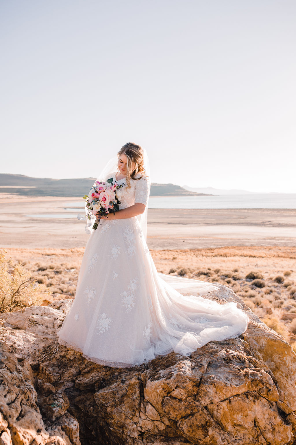 Antelope Island Salt Lake City utah lace wedding dress pink bouquet sunset