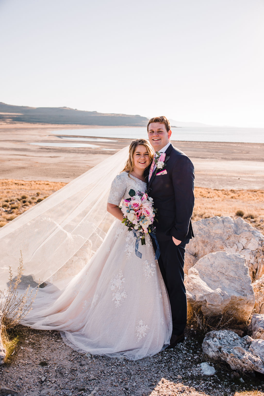 long veil lace wedding dress pink bouquet smiling antelope island great salt lake