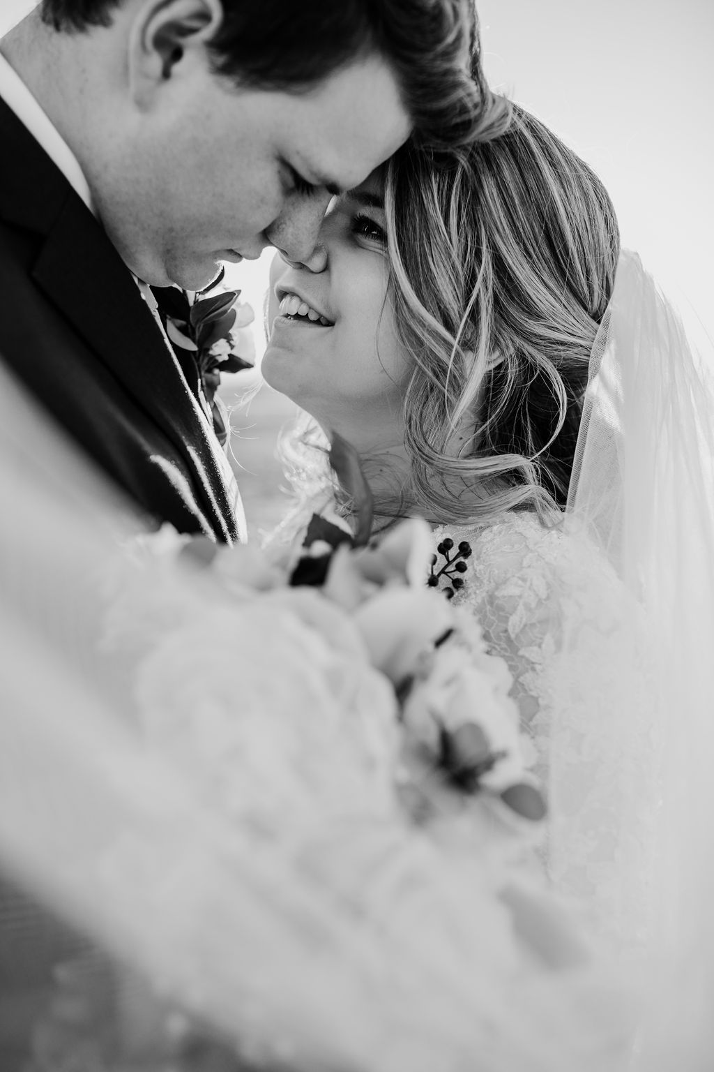 billowy veil smiling hugging romantic lace dress salt lake city wedding photographer