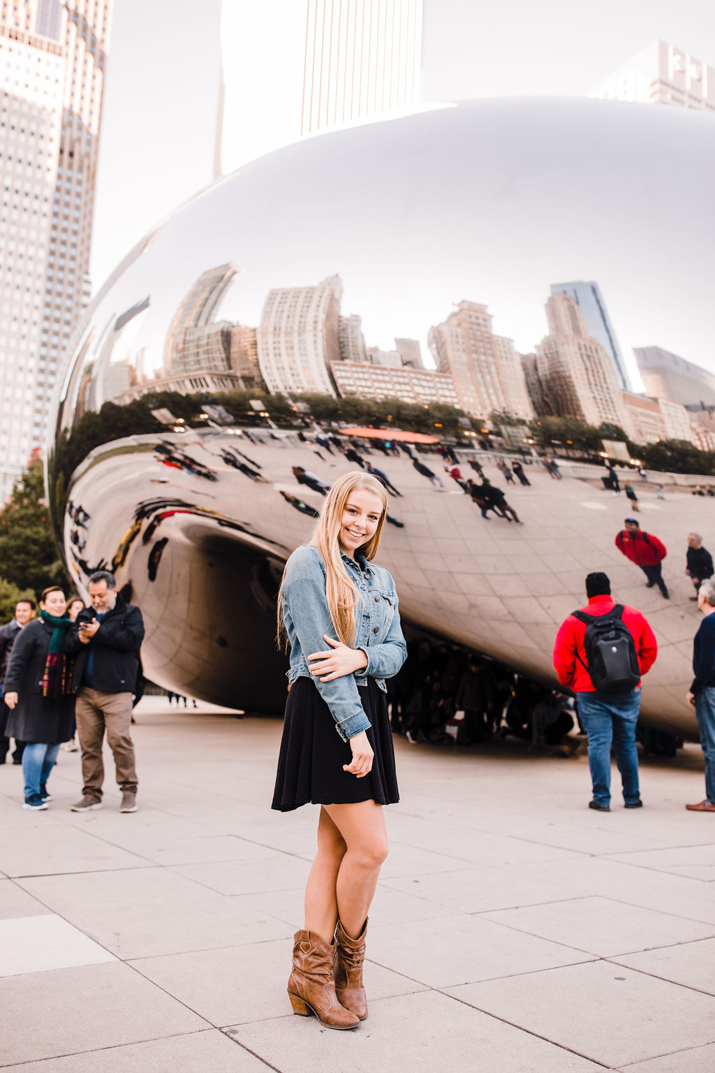professional senior portrait photographer chicago illinois the bean smiling playful denim jacket