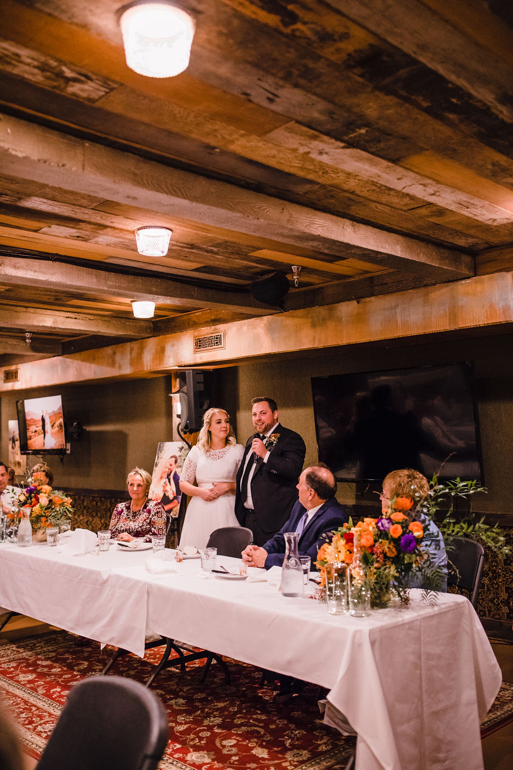 reception toast wooden beams rustic wedding professional ogden utah photographer wedding