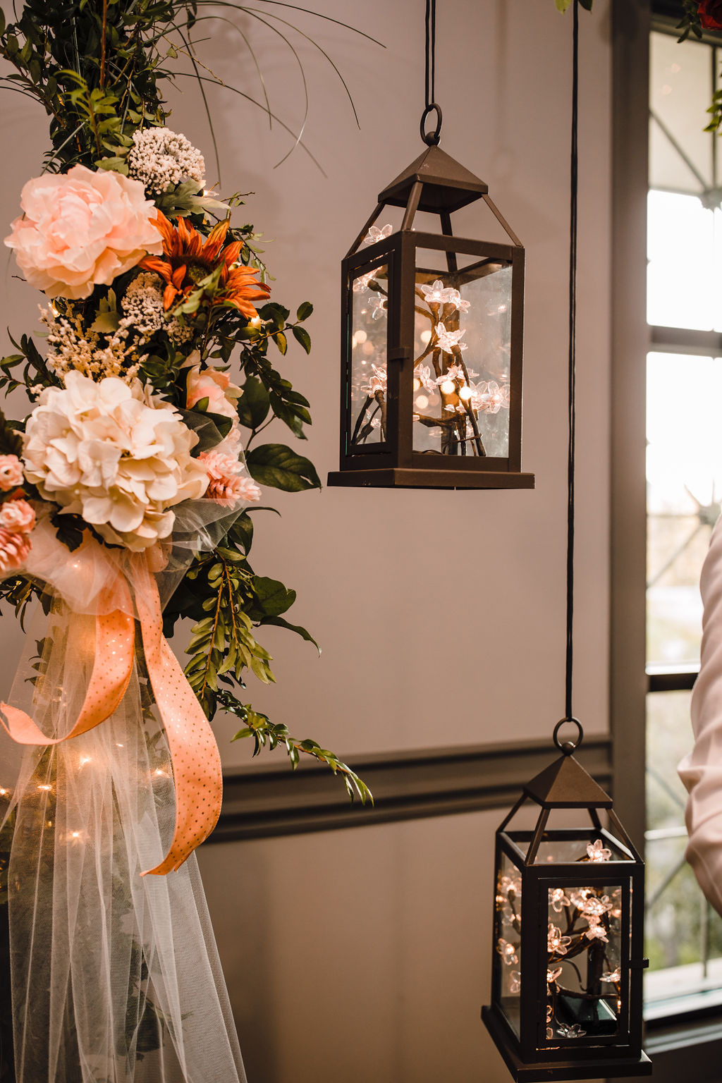 reception decor orange and white flower wreath lanterns rustic professional ogden utah wedding photographer