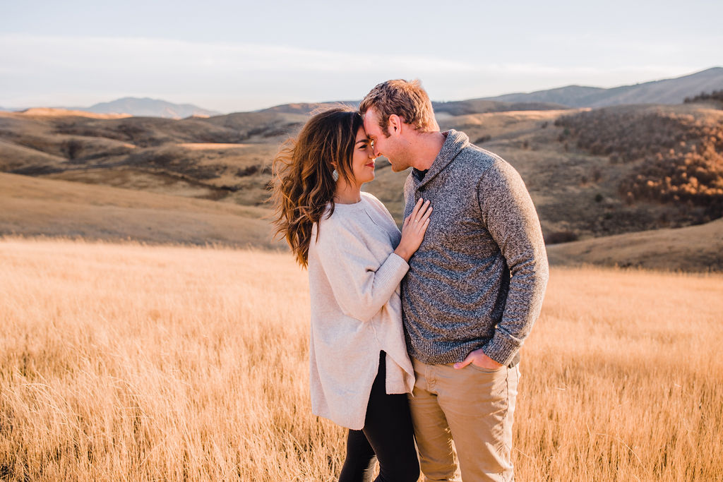 northern utah couples photographer calli richards romantic couple faces touching about to kiss mountains