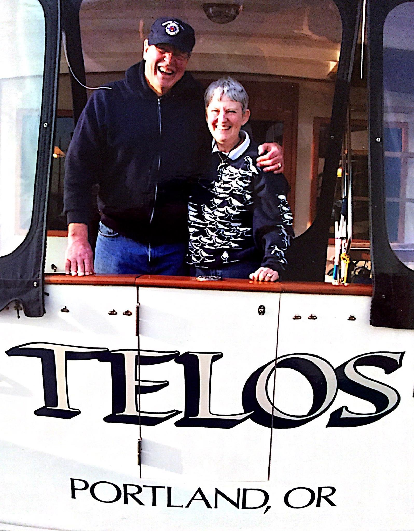 "Shaun's parents, Terry and Julie Hazelton, on their boat ""Telos""."