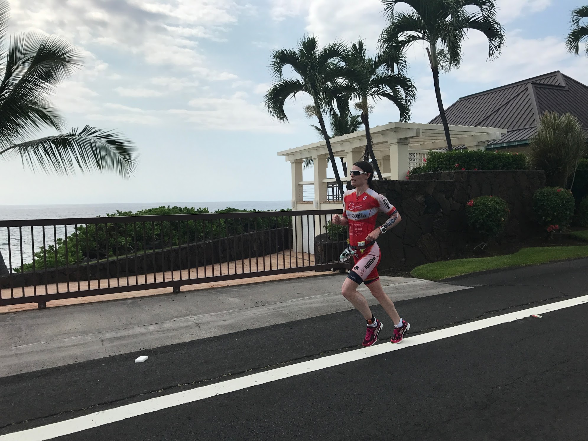 A definite change in running form as she sets off on Ali'i Drive, IRONMAN World Championships