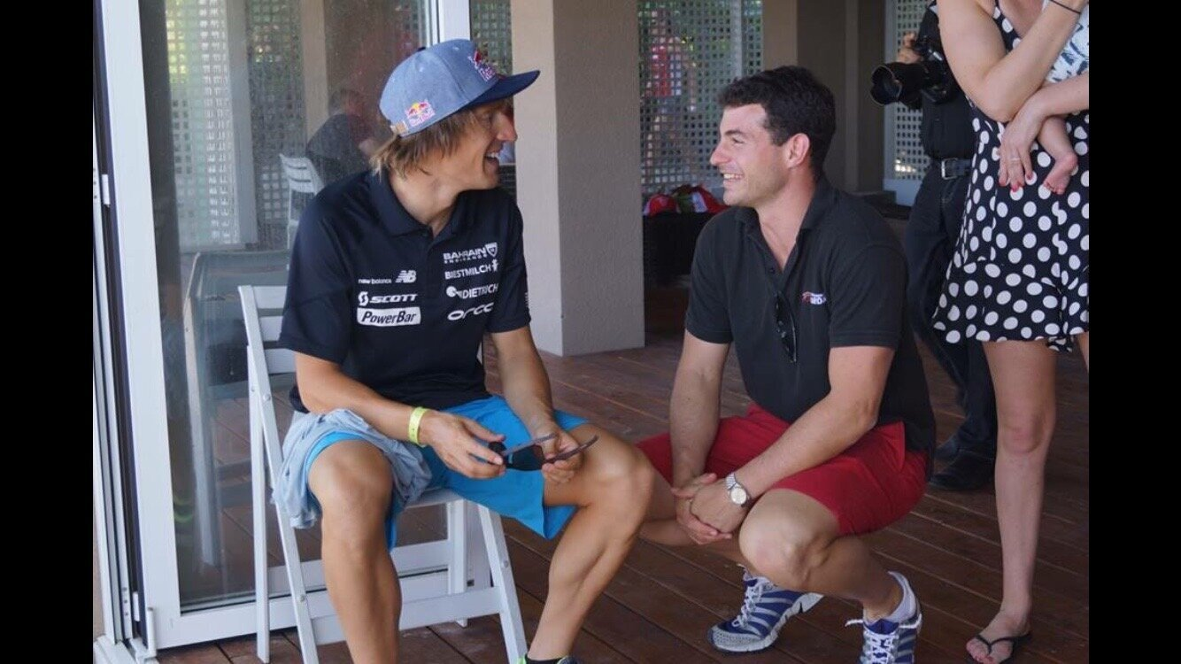 Coach Philip offers words of wisdom to Sebastien Kienle…or Philip just made a funny…we don't know which is more likely!