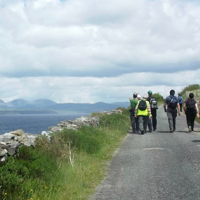 Local hillwalkers along Kenmare Bay.
