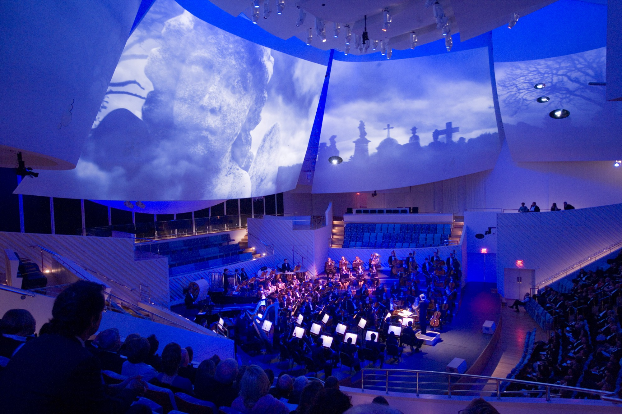 New World Symphony Hall with the giant curved sails above the stage in Frank Gehry's signature twisting and organic style, on which the video is projected. (photo: New World Center)