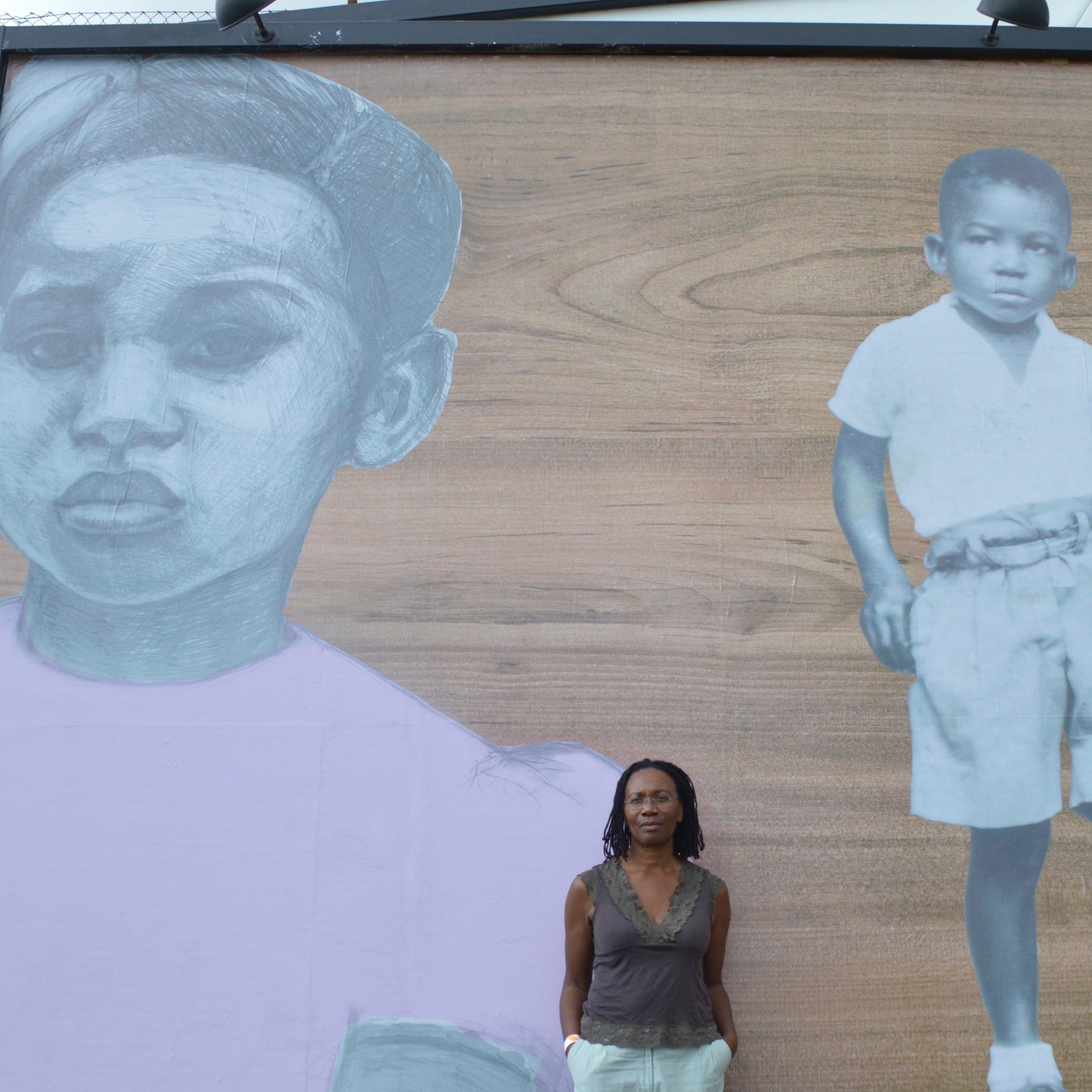 Valda with Mural 2.jpg