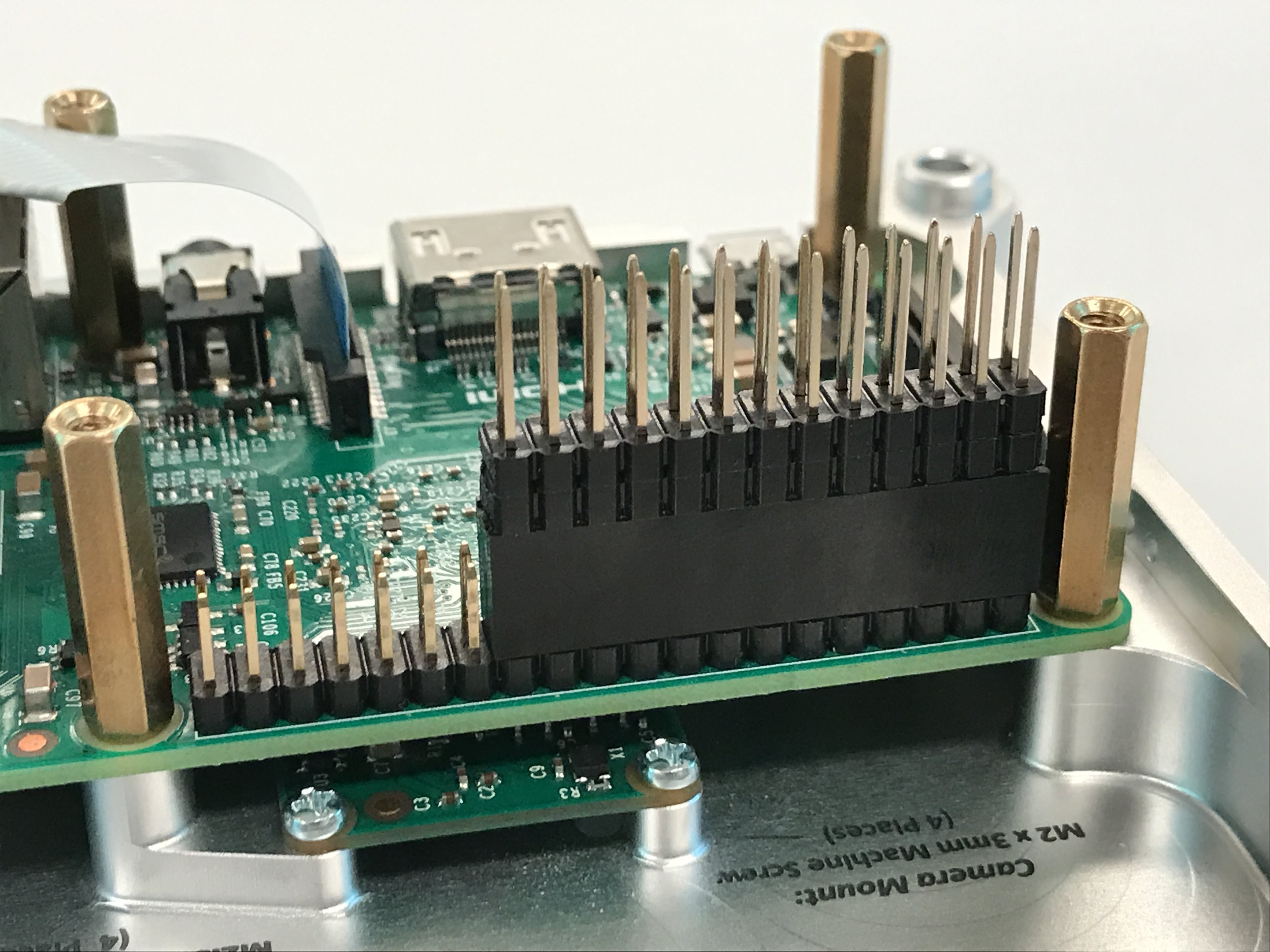 - Add the extended 2X13 pin (26-way) header to the Raspberry Pi GPIO pins, on the side opposite from the USB ports.Make sure to push down firmly and seat the header all the way down onto the GPIO base.Now go to Step 3: Install Push-Button Switches