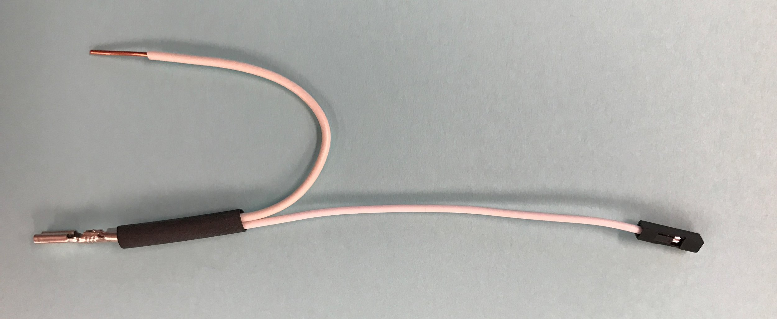 - Now, take a white jumper wire and remove the plastic sheath from one end, to expose the connector, just as you did to create a button wire (above).Hold the connector next to one end of one of your 10cm wire U-shapes.Insert both wires together into a crimp and compress the crimp until the wires are firmly held together.