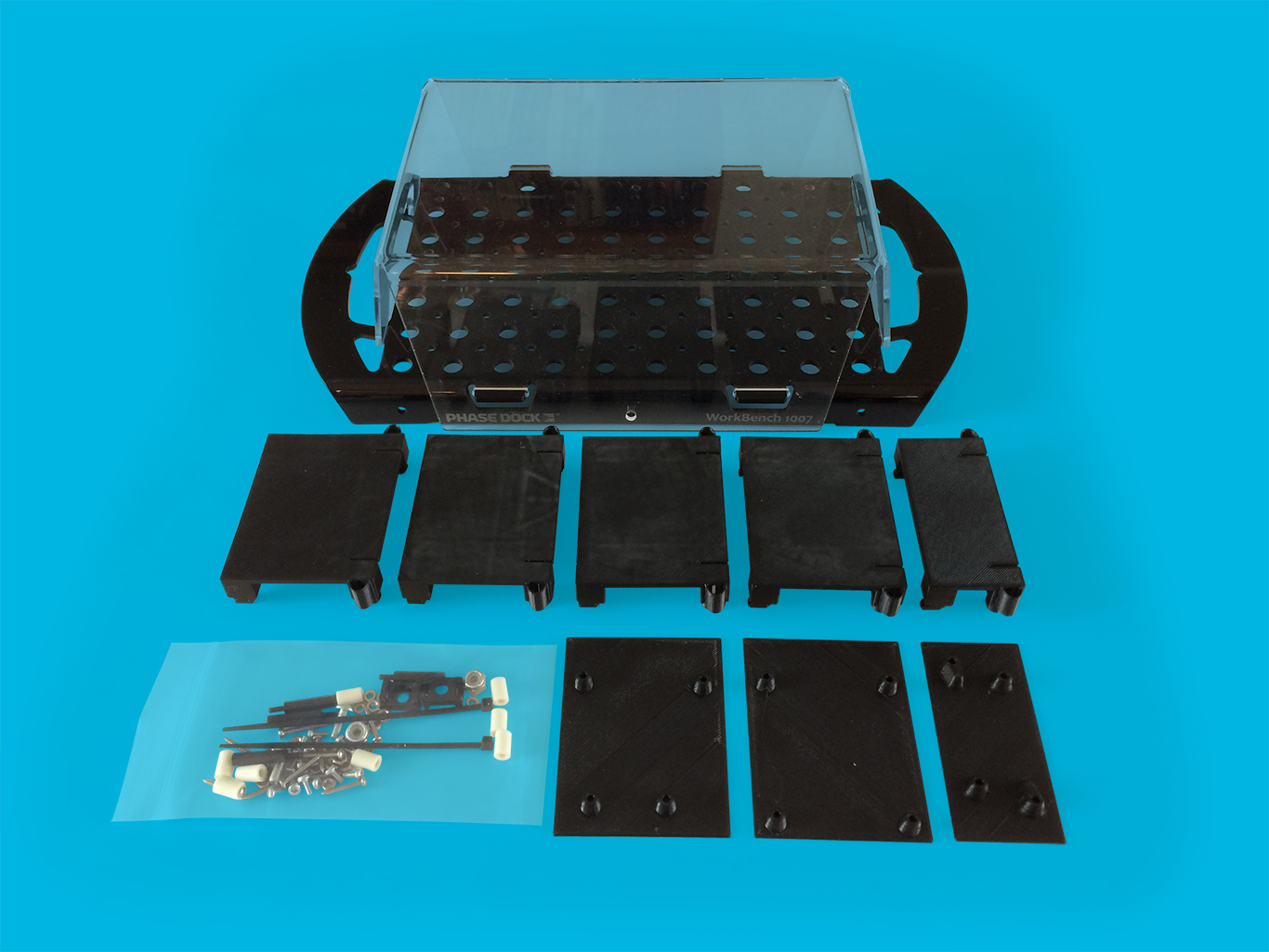 "WorkBench 1007 PDK - You bring the electronics. We provide everything else to make your project look amazing and professional.$69.95 - $79.95Base with 10x7 matrix (54 sq in of work surface)Clear acrylic Cover Five Clicks, 2 sizes (used to mount electronics) Three Slides, adapters for Arduino (1 ea), Raspberry Pi 2/3 (1 ea), and Feather/Particle (1 ea) boards Hardware packet — saves you timeDetailed 1007 Kit contents and specificationsVideo: ""This is WorkBench""Electronics Mounting Guide"