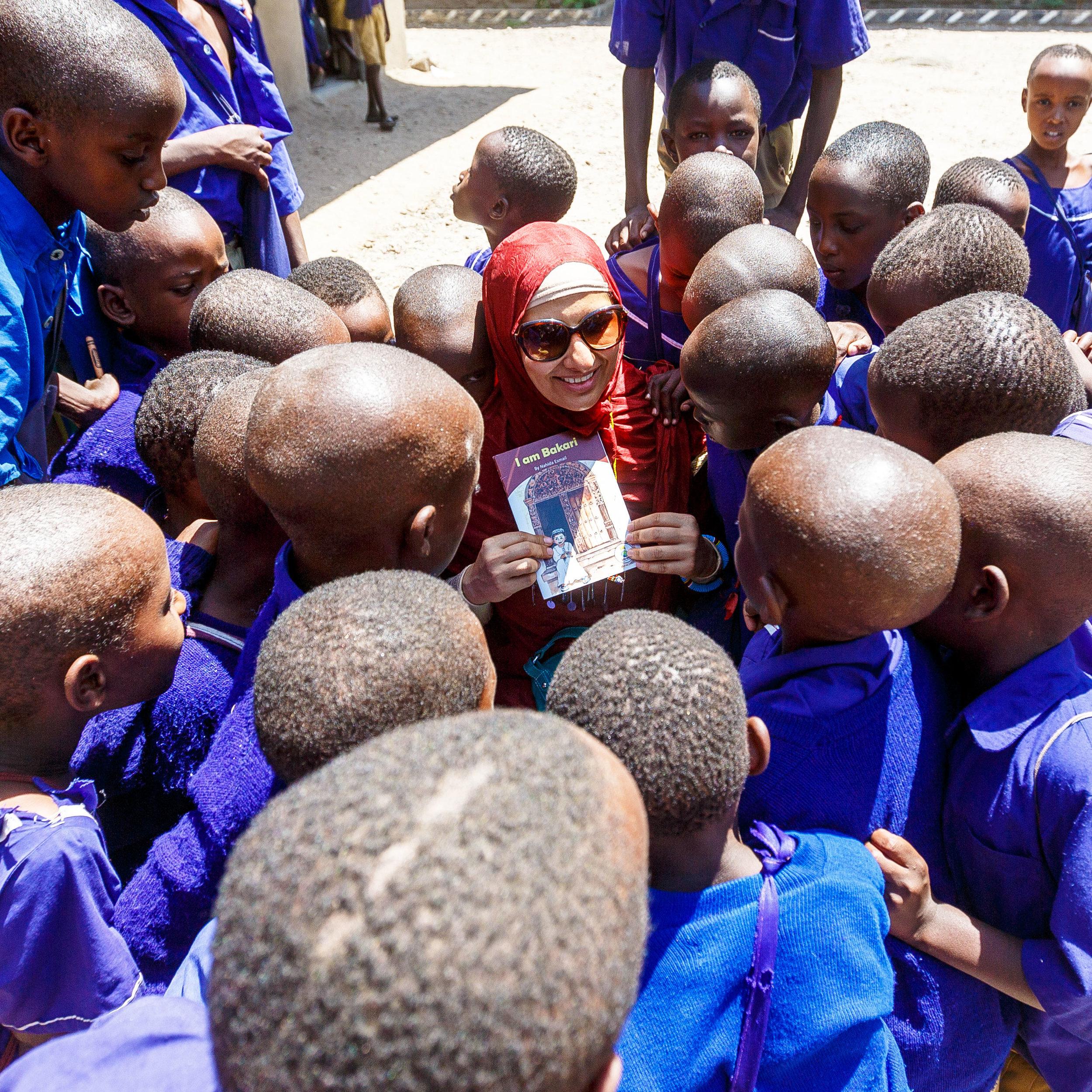 Showing children one of my books in Ketumbeine, Tanzania