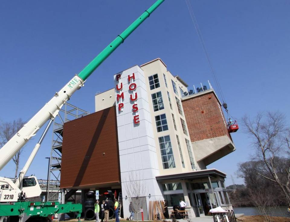 industrial pump house becoming riverside eatery -