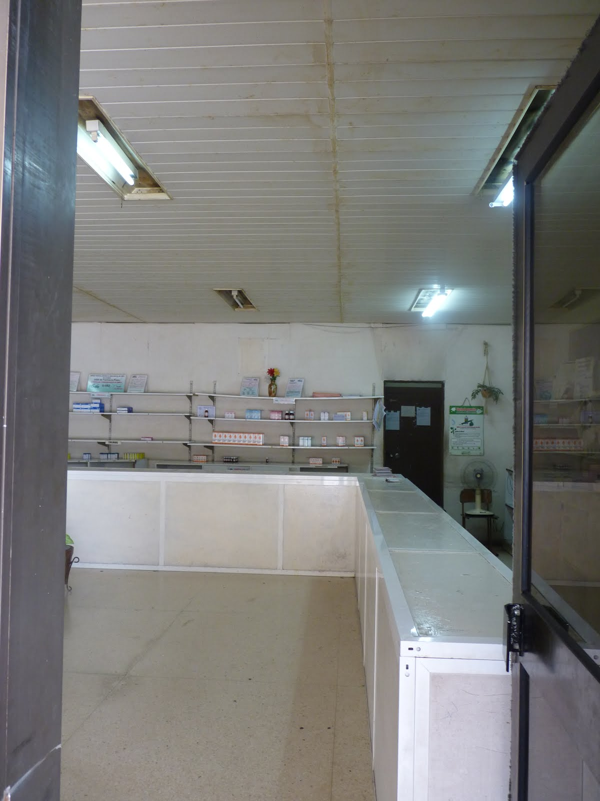 A local pharmacy in the bottom stores of the FOCSA building. The shelves are bare. Upon my taking of the picture, a nurse shooed me away.