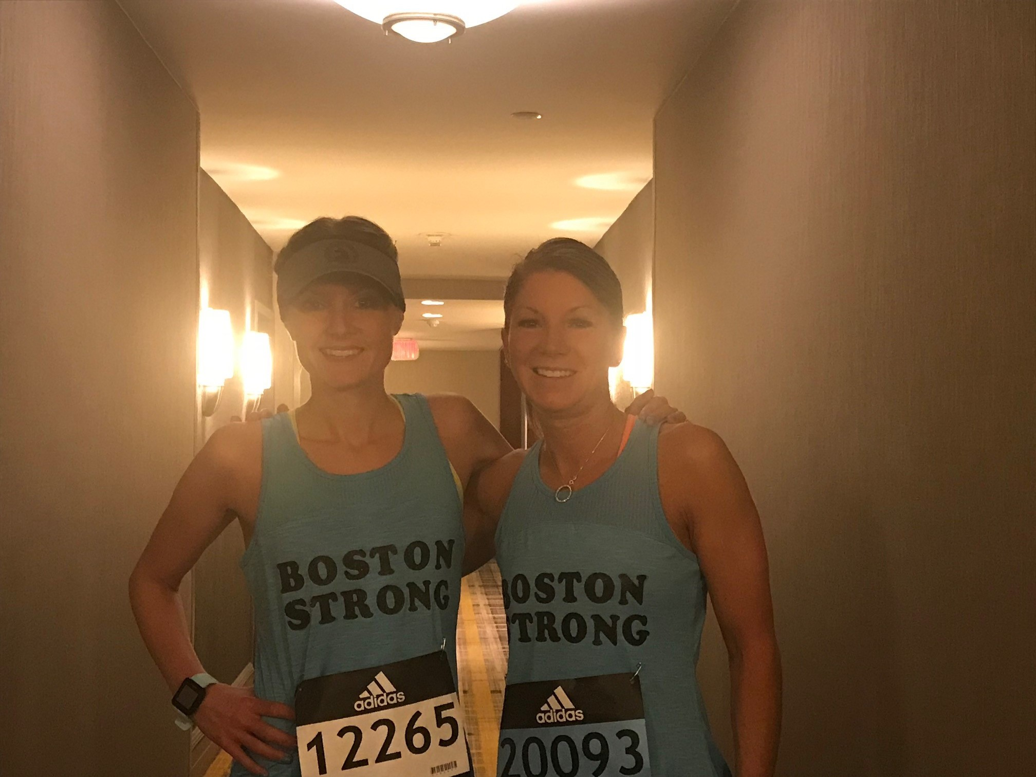 Not exactly tank-top weather. - Michelle often runs with her sister-in-law, Jess Feda. Because they couldn't run in these tanks, they had to snag a photo before the race.