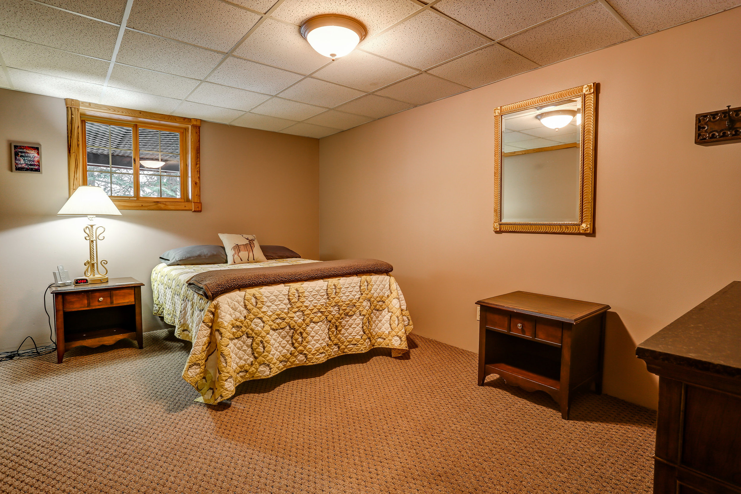 Happy Camper Room - Downstairs | Queen bed and shared bathroom in hallway