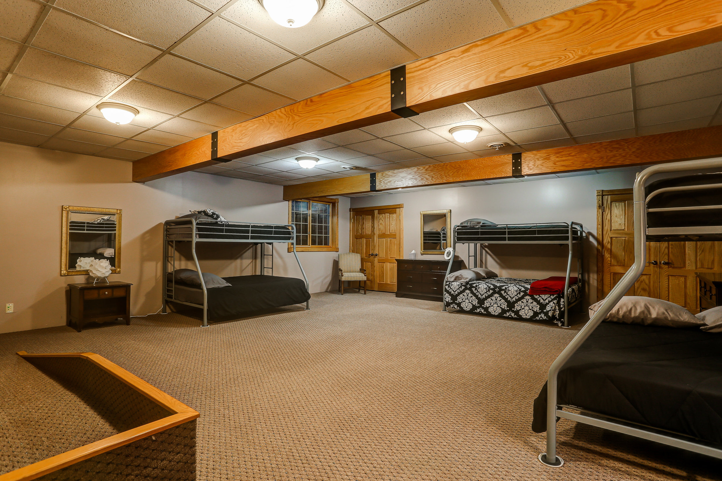 Bunk Room - Downstairs | Full bed bottom bunks and shared bathroom in hallway