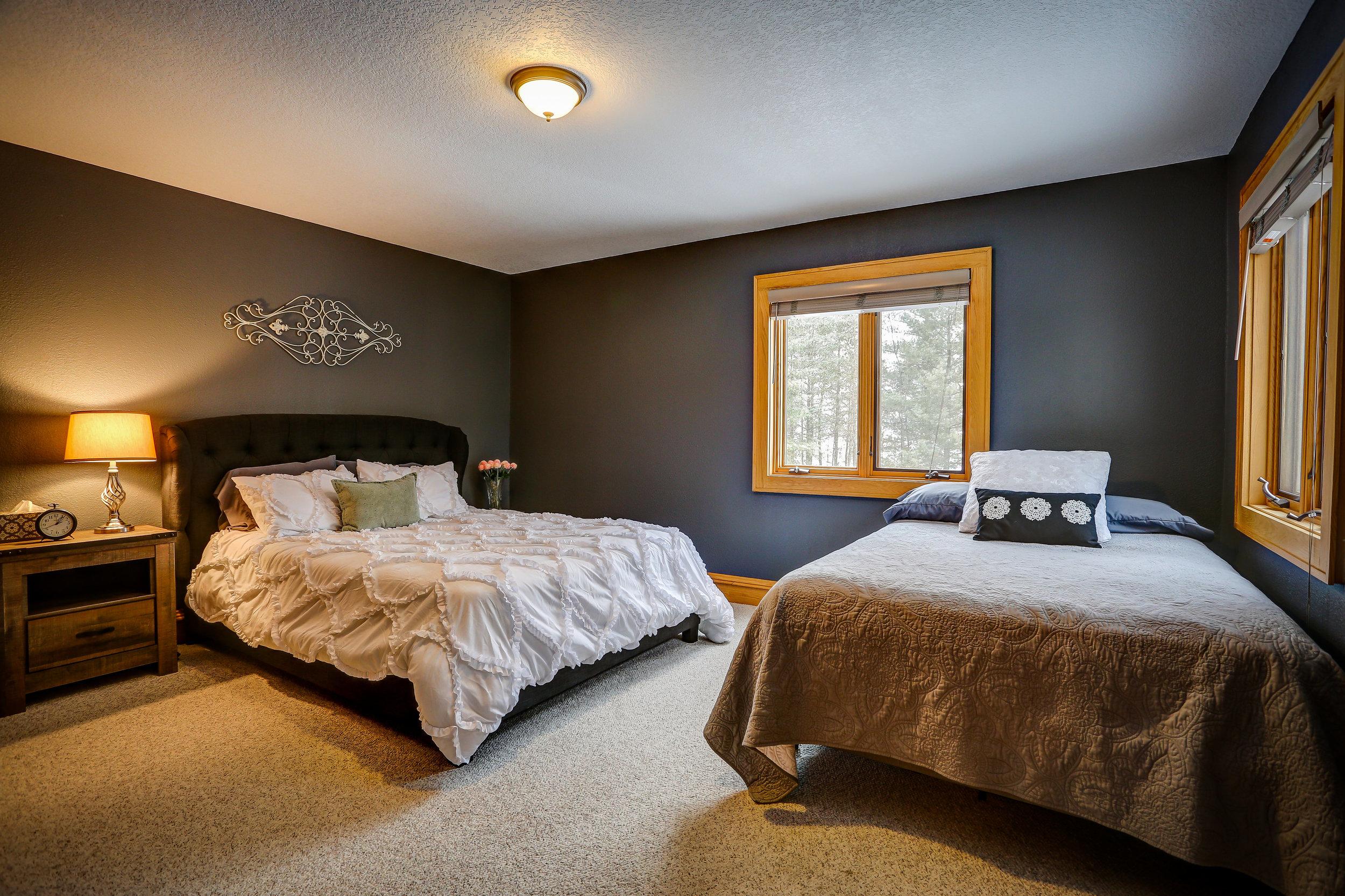 Main Floor Bedroom - Main Level | 1 queen bed + 1 full bed and shared bathroom in hallway