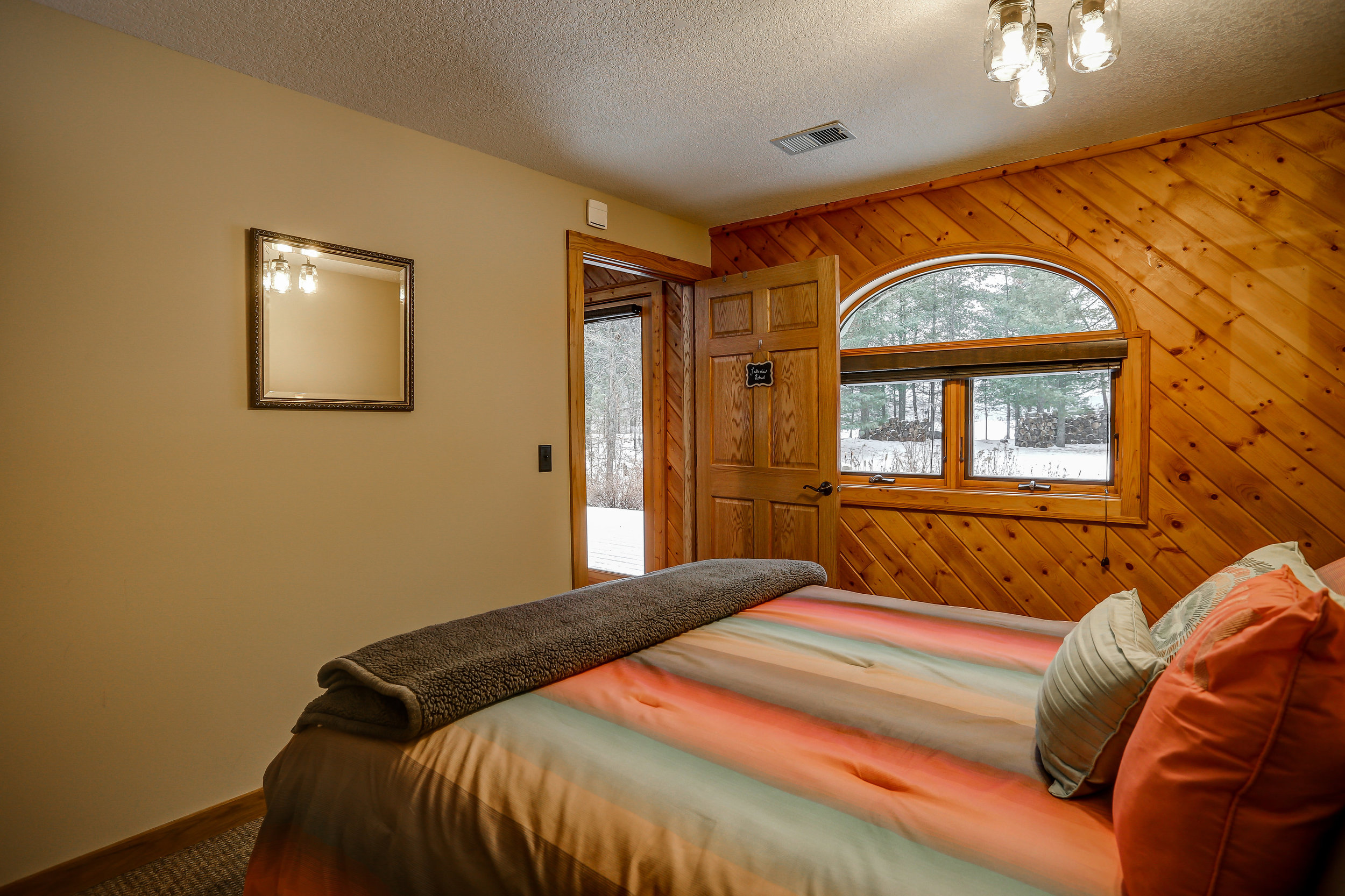 River Rock Room - Downstairs | Queen bed and shared bathroom in hallway