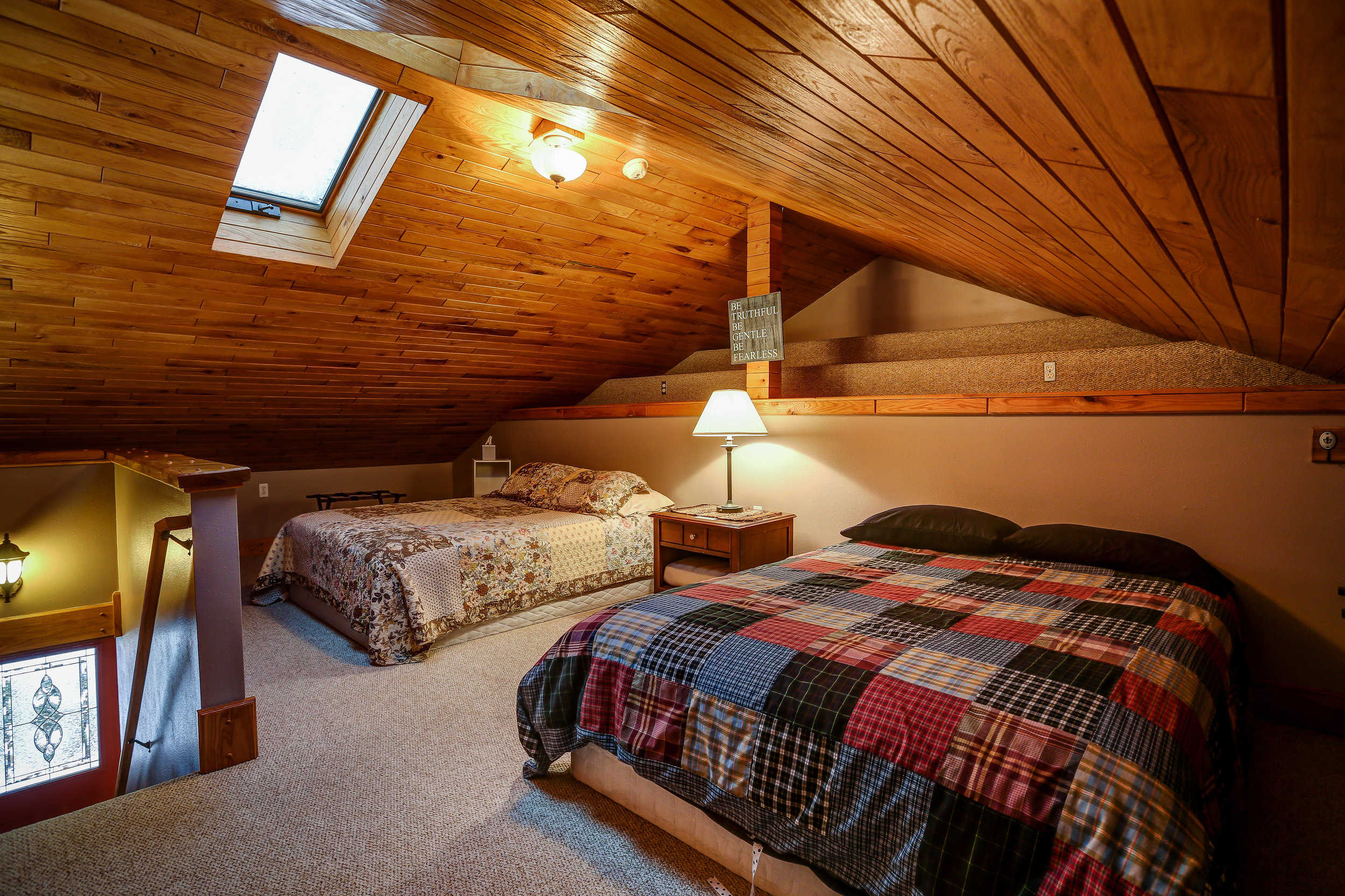 Living Room Loft - Upstairs | Two queen beds and shared bathroom on main level