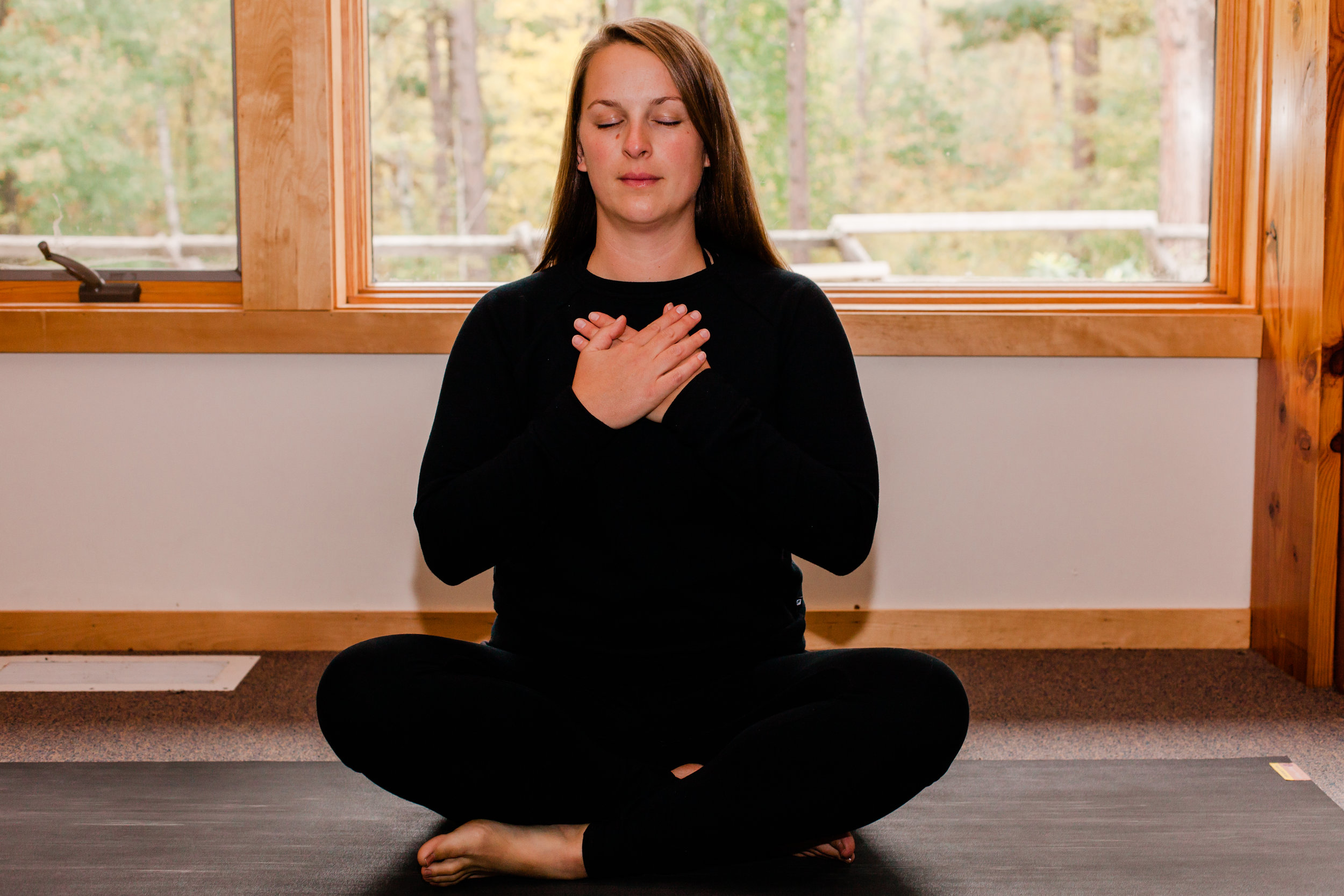 When we slow down our breathing, and extend our exhales longer than our inhales, we activate the parasympathetic nervous system, or rest-and-digest response. Our breath signals to our brain that it is okay to slow down and rest. Practicing this technique throughout the day, such as in the car, before meetings, and before lunch can help you build muscle memory around a breathing practice. The goal being- when moments of stress do come up (fight-or-flight), you will be able to tap into your breathing practice to calm down. A simple way to practice is to count on your inhale (say up to 4), and then double the count on the exhale (in this example 8).  Try using this breathing technique throughout the postures below. After a while you will fall into rhythm with your breath and the counting will no longer be necessary.