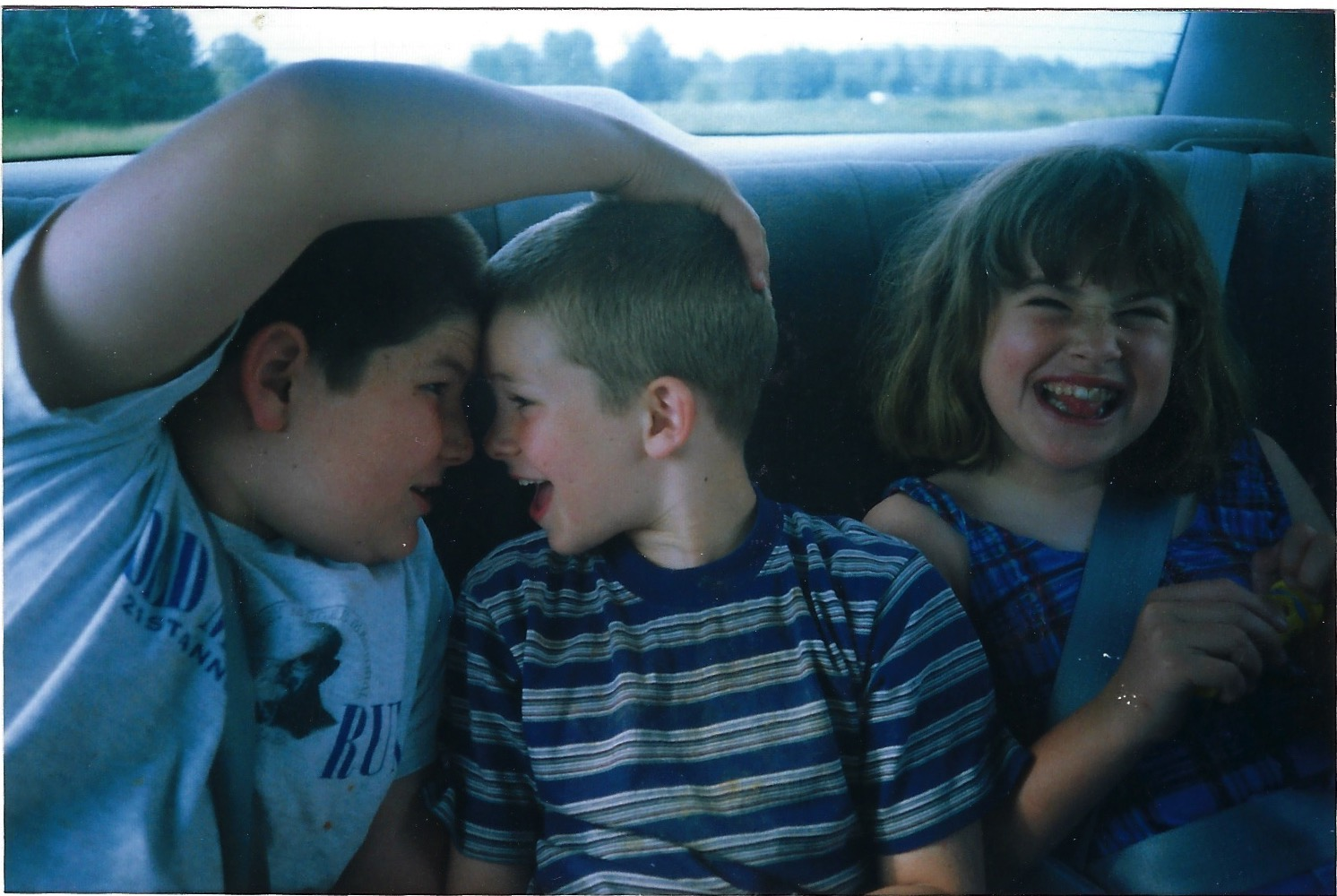 - Hallie and her brothers on a road trip as kids.
