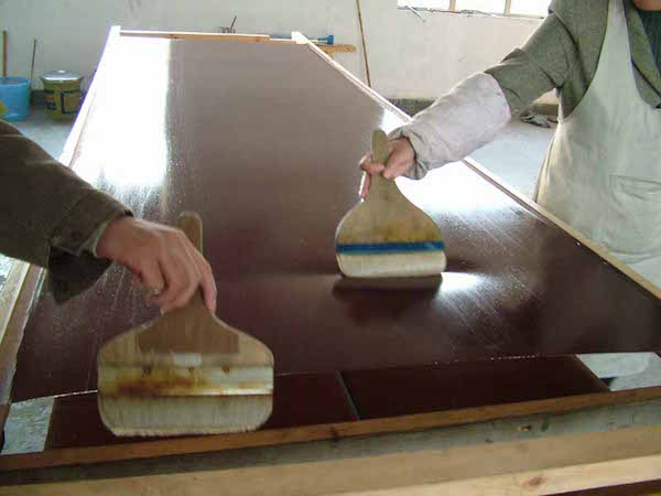 The silk is treated prior to being painted