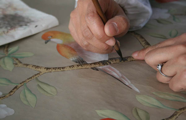 The painting process involves the addition of more and more layers of colour