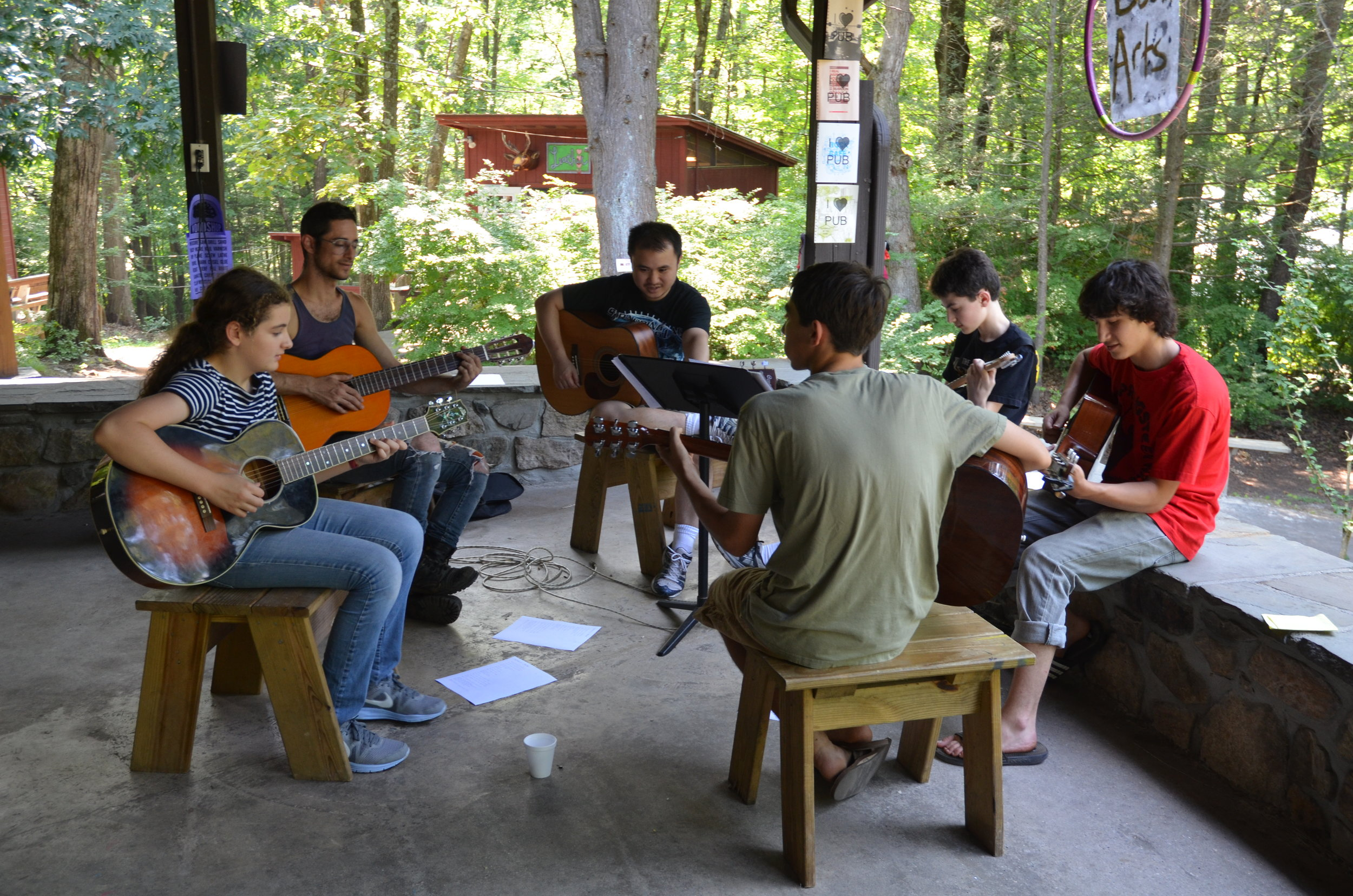 "The Porch of the historic Dining Hall, setting for ""Guitar Snack"" and many more fun camp activities."
