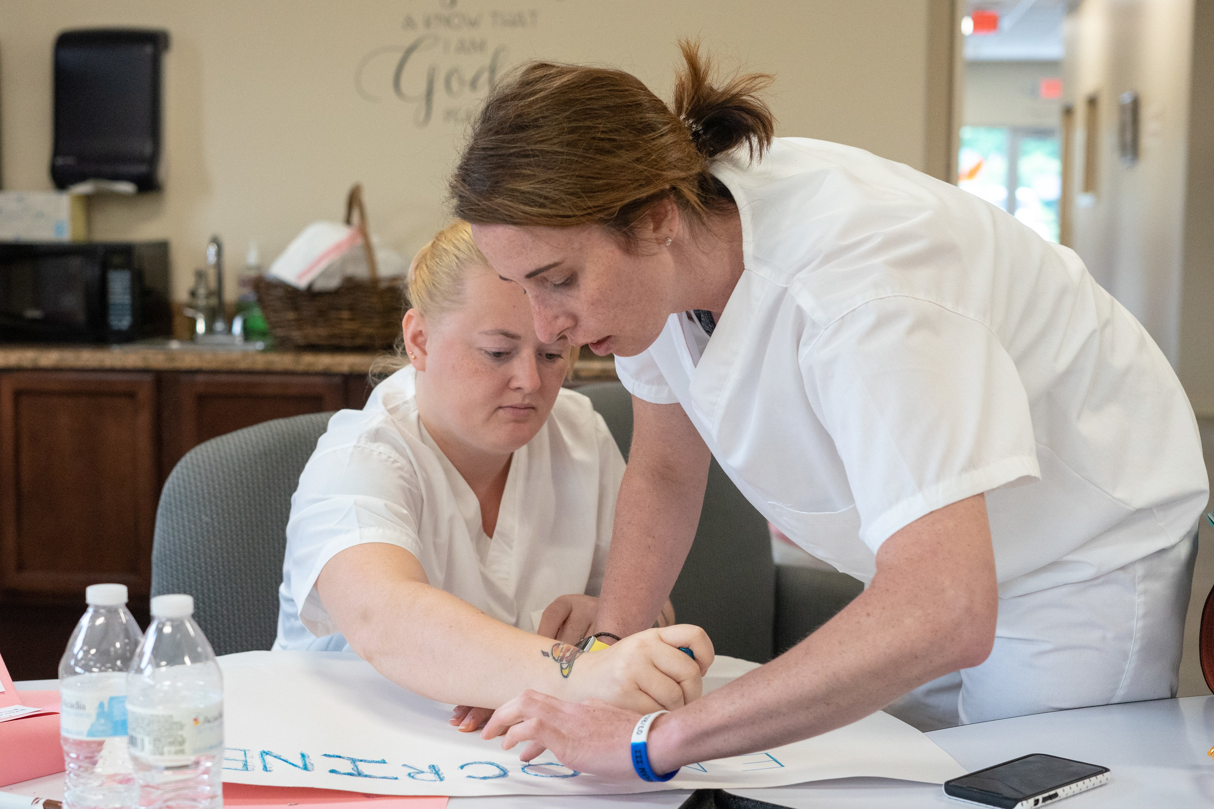 Destiny (left) and Claire (right) work on their class presentation on the Endocrine system at New Hope Ministries. Claire has overcome financial and medical difficulties and is hoping that the completion of the Nurse Aide program will set her on a fresh track.