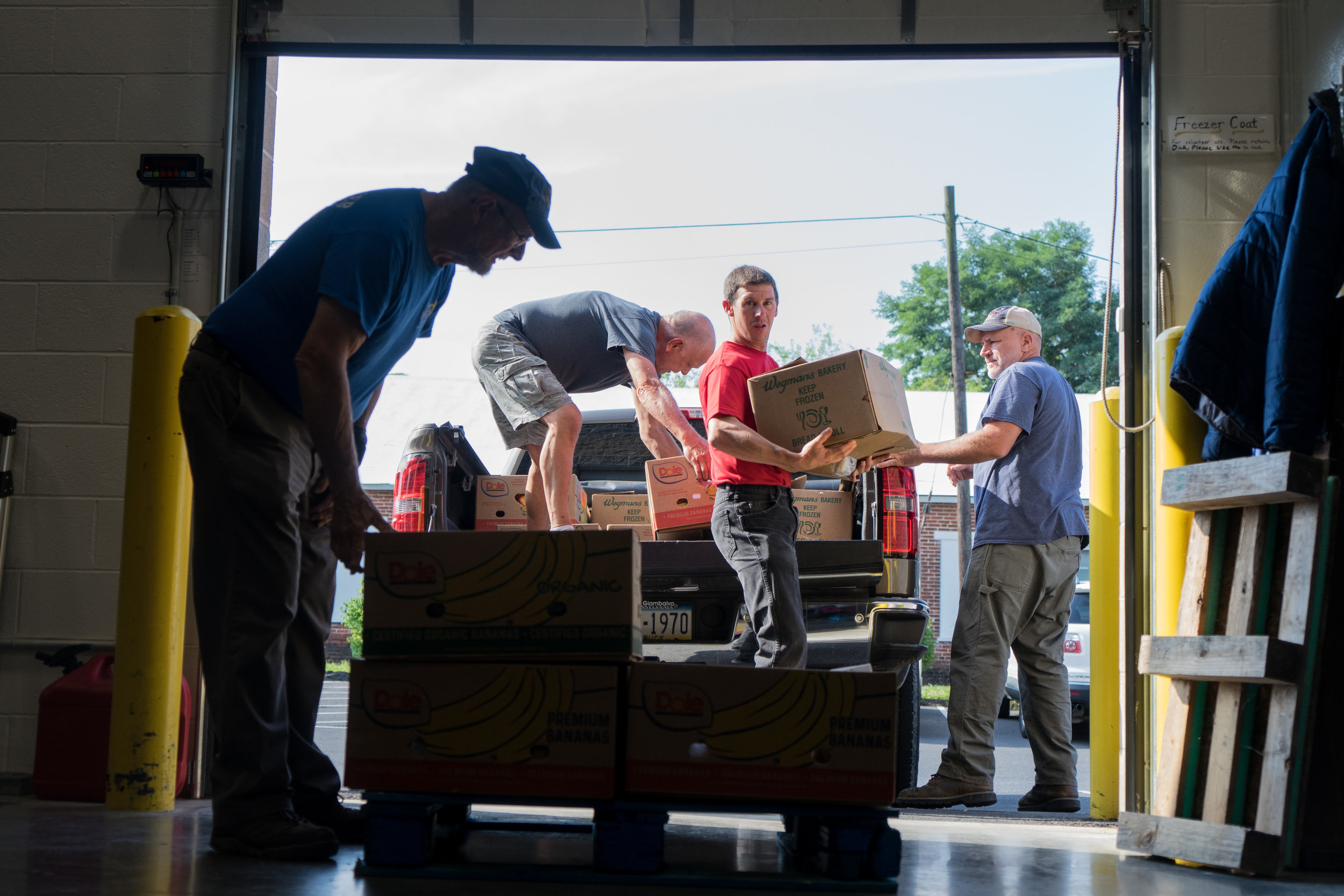 New Hope volunteers unload a truck of fruit from local grocery stores in Dillsburg, PA. Stores donate their slightly old produce to the pantry.