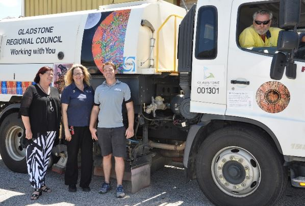 GRC councillor Cindi Bush, gallery & museum curator Jo Duke and Ben Hughes from one of the local printers that installed the artwork check out Bindi Waugh's design on a street sweeper, with Mick McCartin at the wheel.