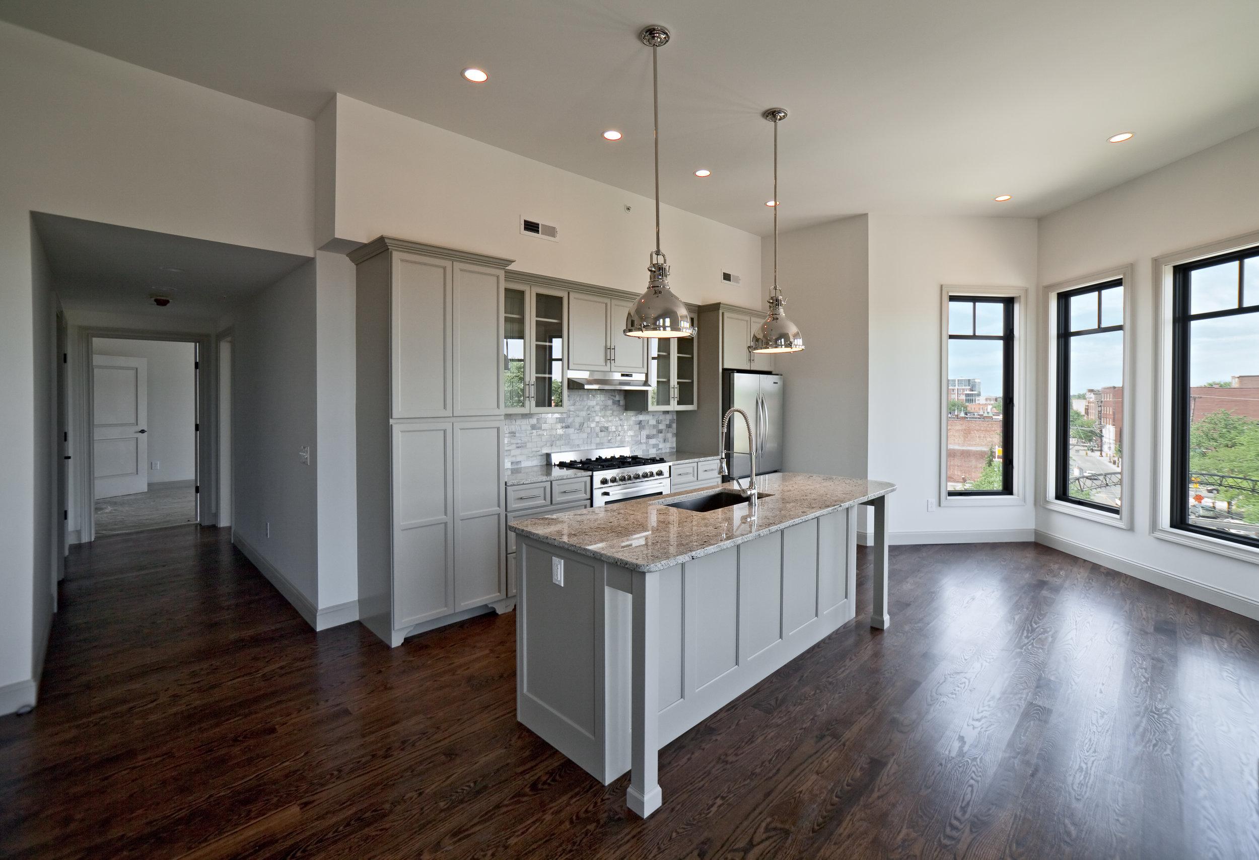 Wood Co. Apartments 4th Floor Kitchen Hi.jpg