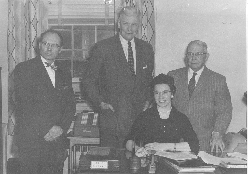 The founders: John Schooley, former State Architect of Ohio, Ray Sims, successful architect and structural engineer, Bert Cornelius, mechanical engineer, and Victoria Fox, their secretary.