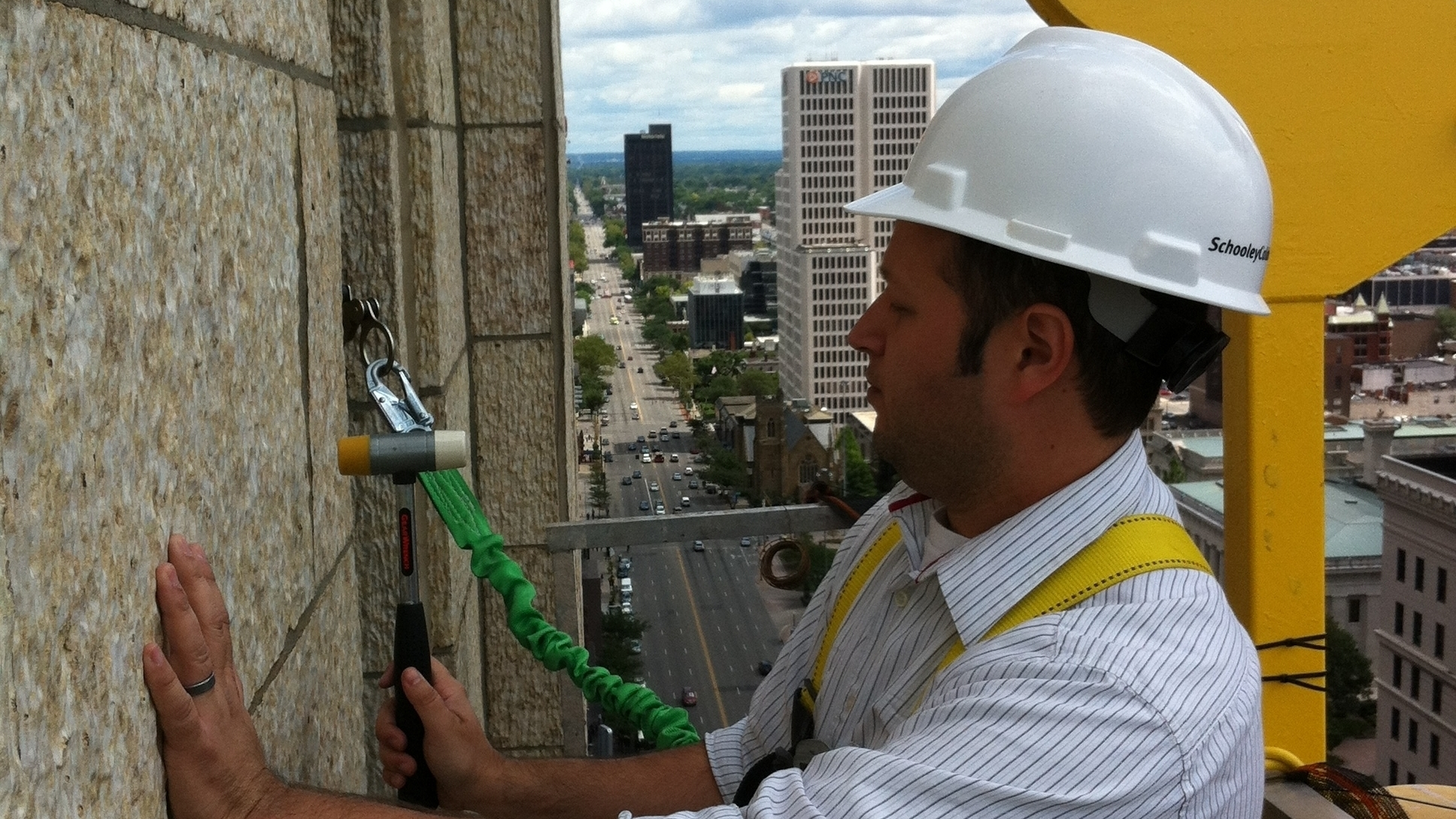 Sam Rosenthal     inspecting the terra cotta at the   LeVeque Tower, Columbus, Ohio