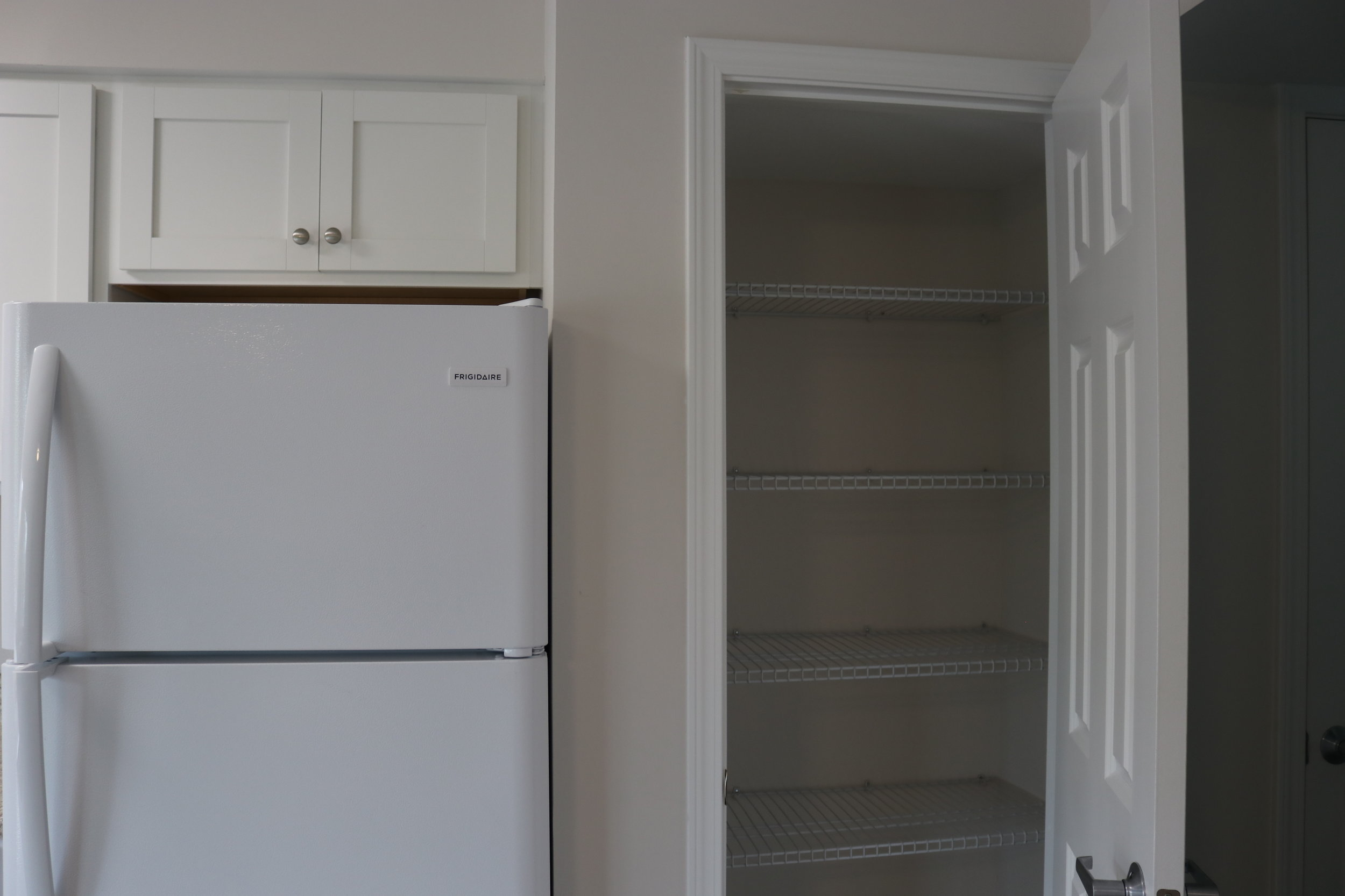 KITCHEN // AFTER:  All new cabinets and closet with ample storage!