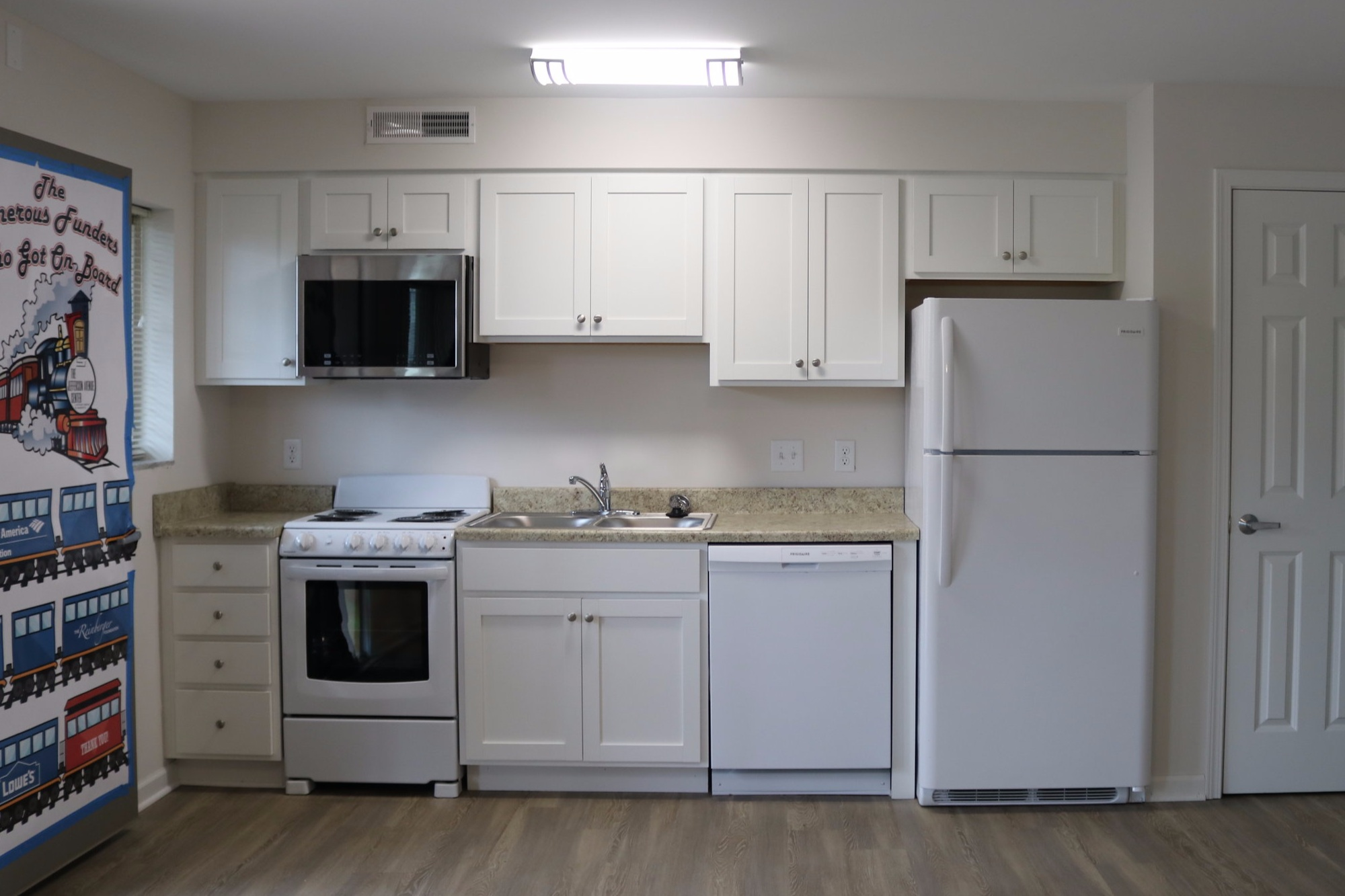 KITCHEN // AFTER:  All new cabinets, appliances, windows, doors, and closet with plenty of storage