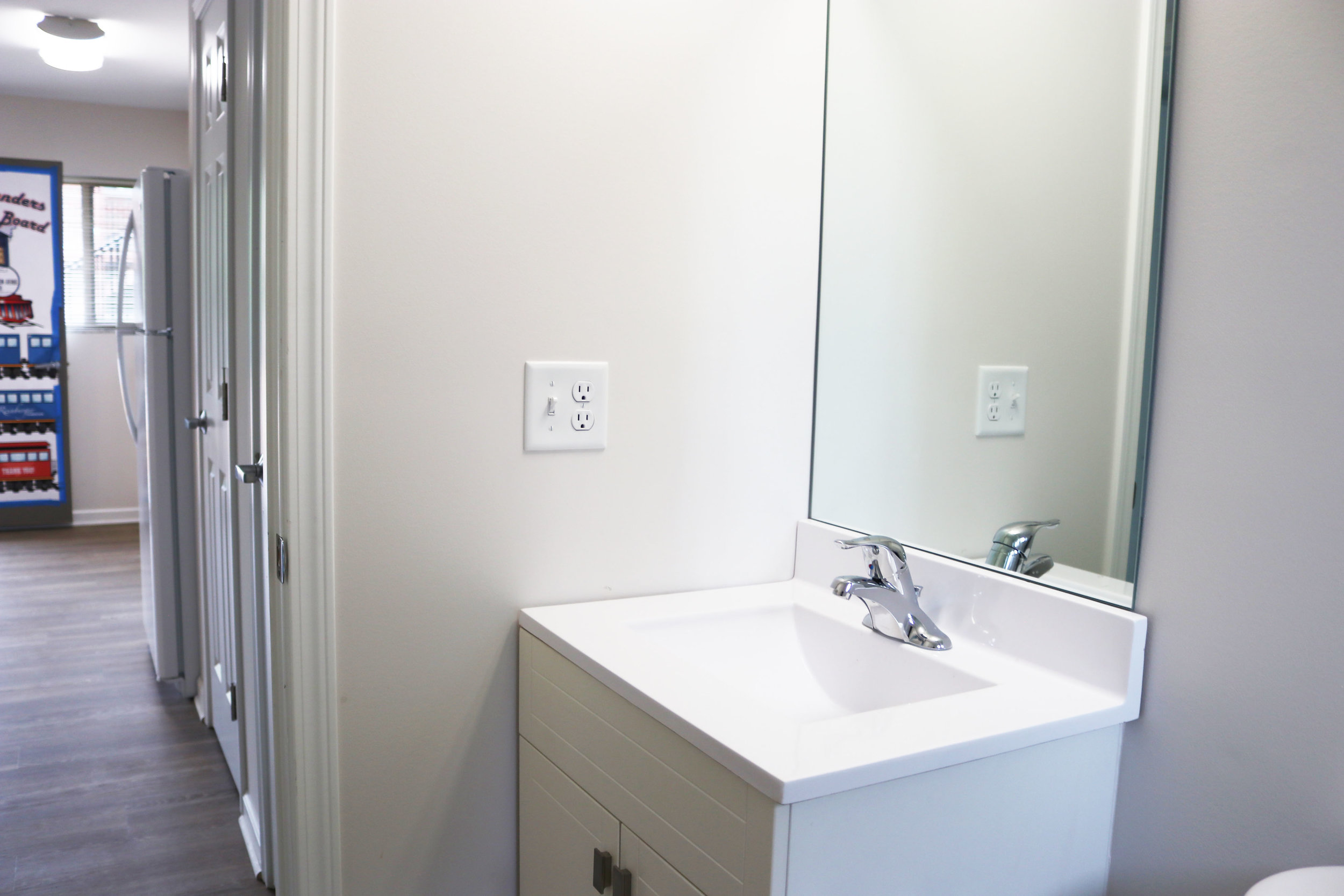 BATHROOM // AFTER:  New bright, fresh look and feel, with brand new vanity and toilet