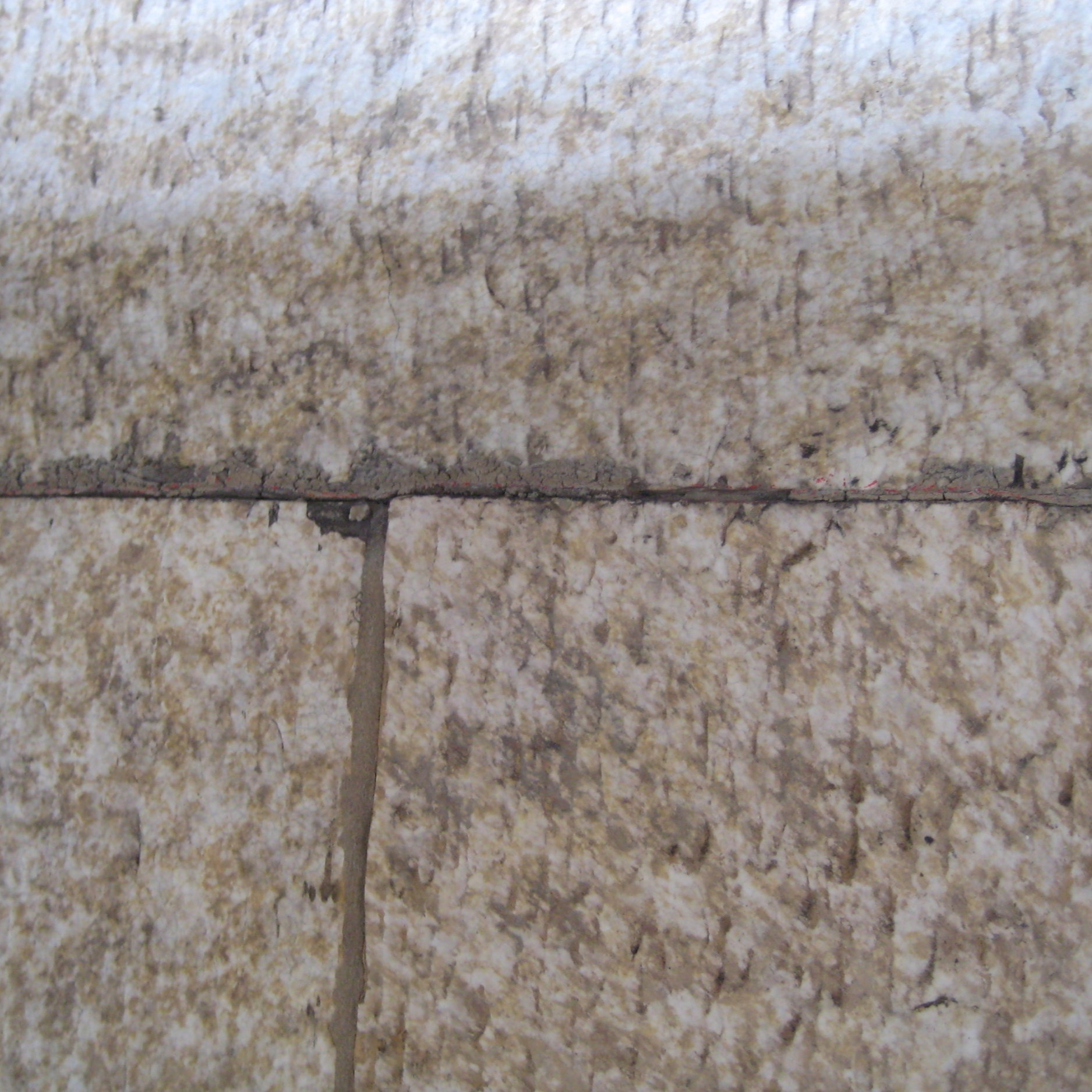 At mortar joints between terra cotta units, either mortar is completely missing or is cracked and is loose within the joint. Or, mortar is attatched to one unit, but the adjacent unit has pulled away from the joint.