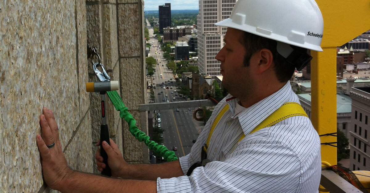 Here I am inspecting the terra cotta at the LeVeque Tower!
